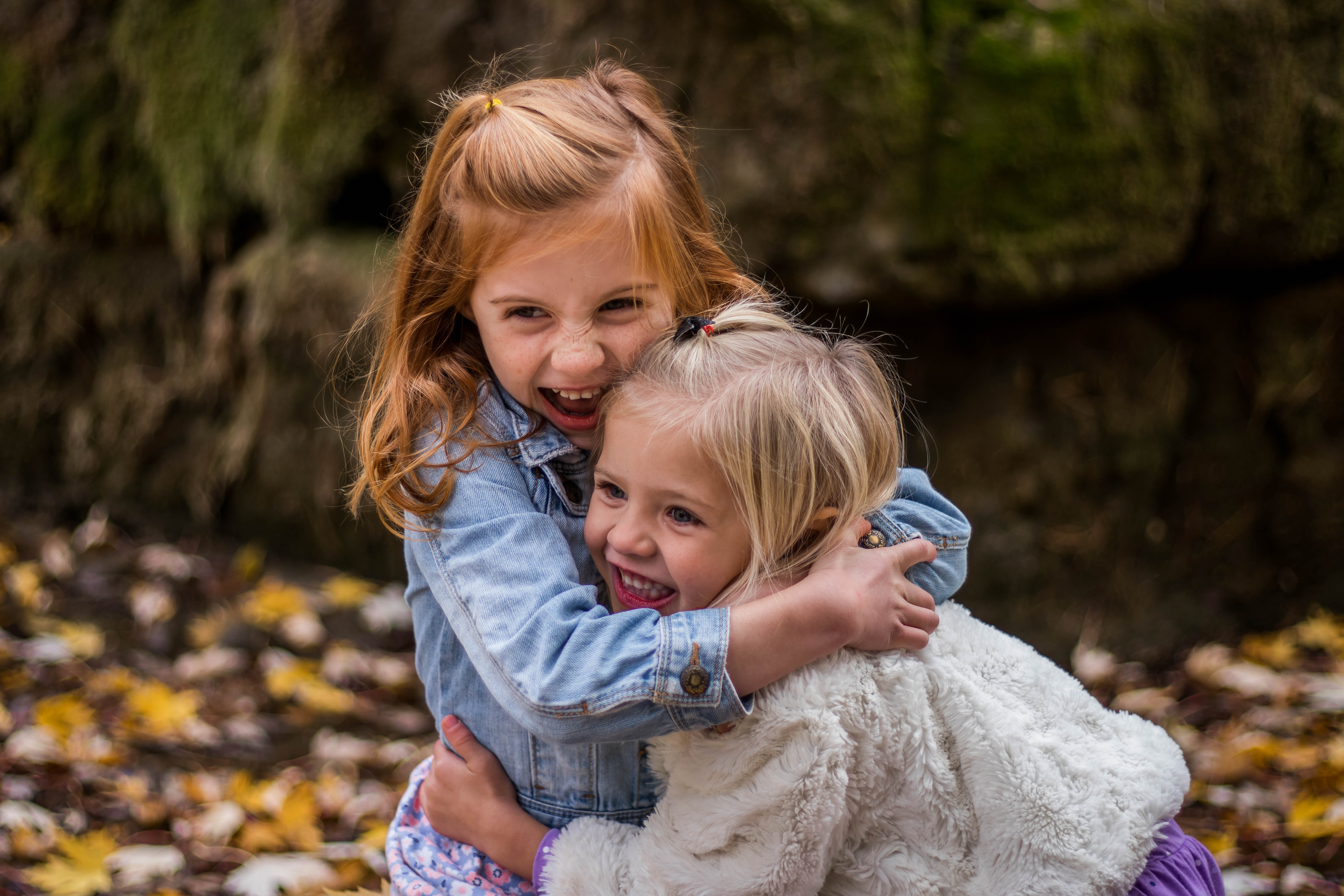 2 Girls Hugging Each Other Outdoor during Daytime, Children, Cute, Excited, Excitement, HQ Photo