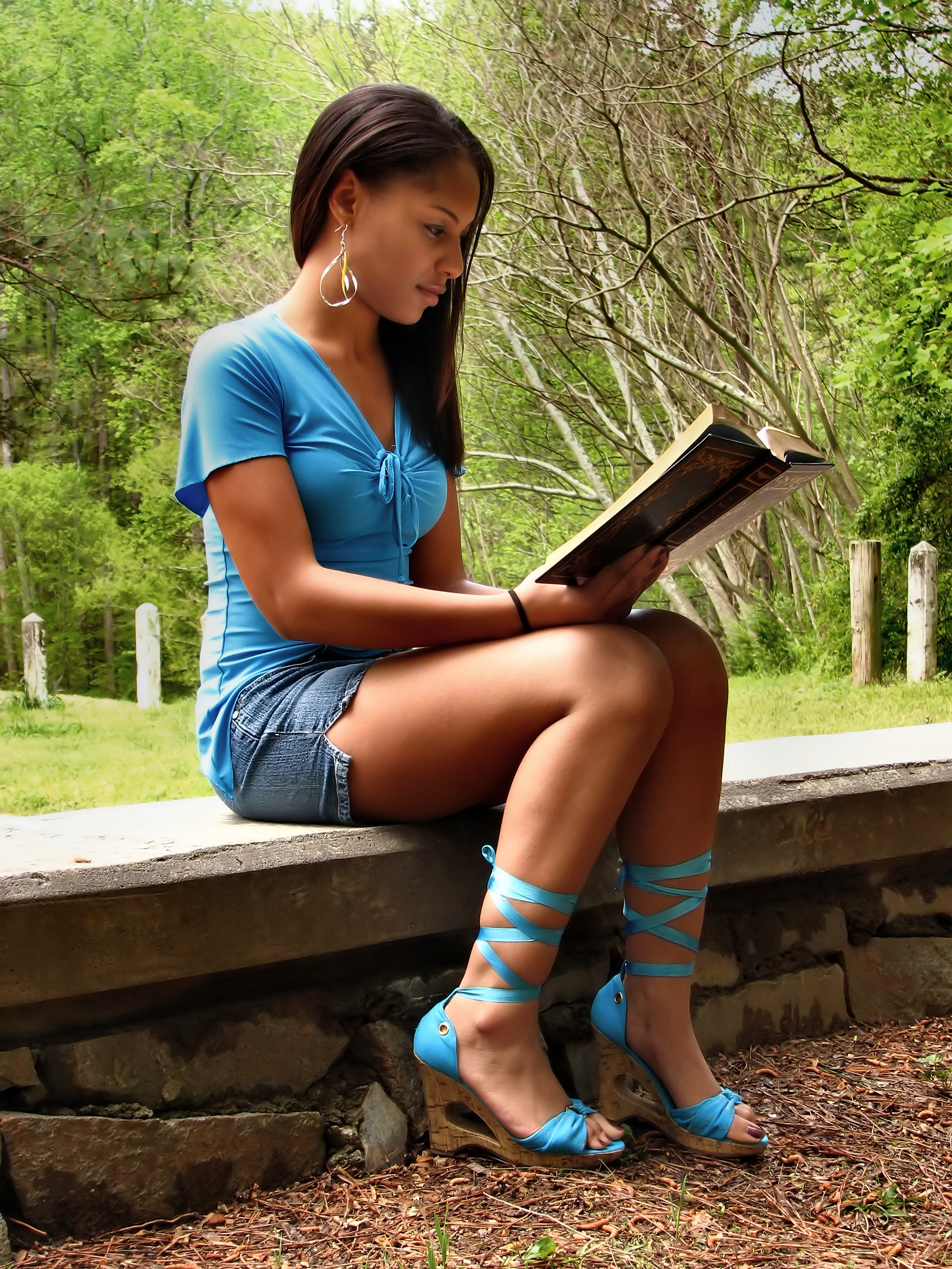 A Beautiful Teen Girl Reading A Book Recreation Reading Stone Trees