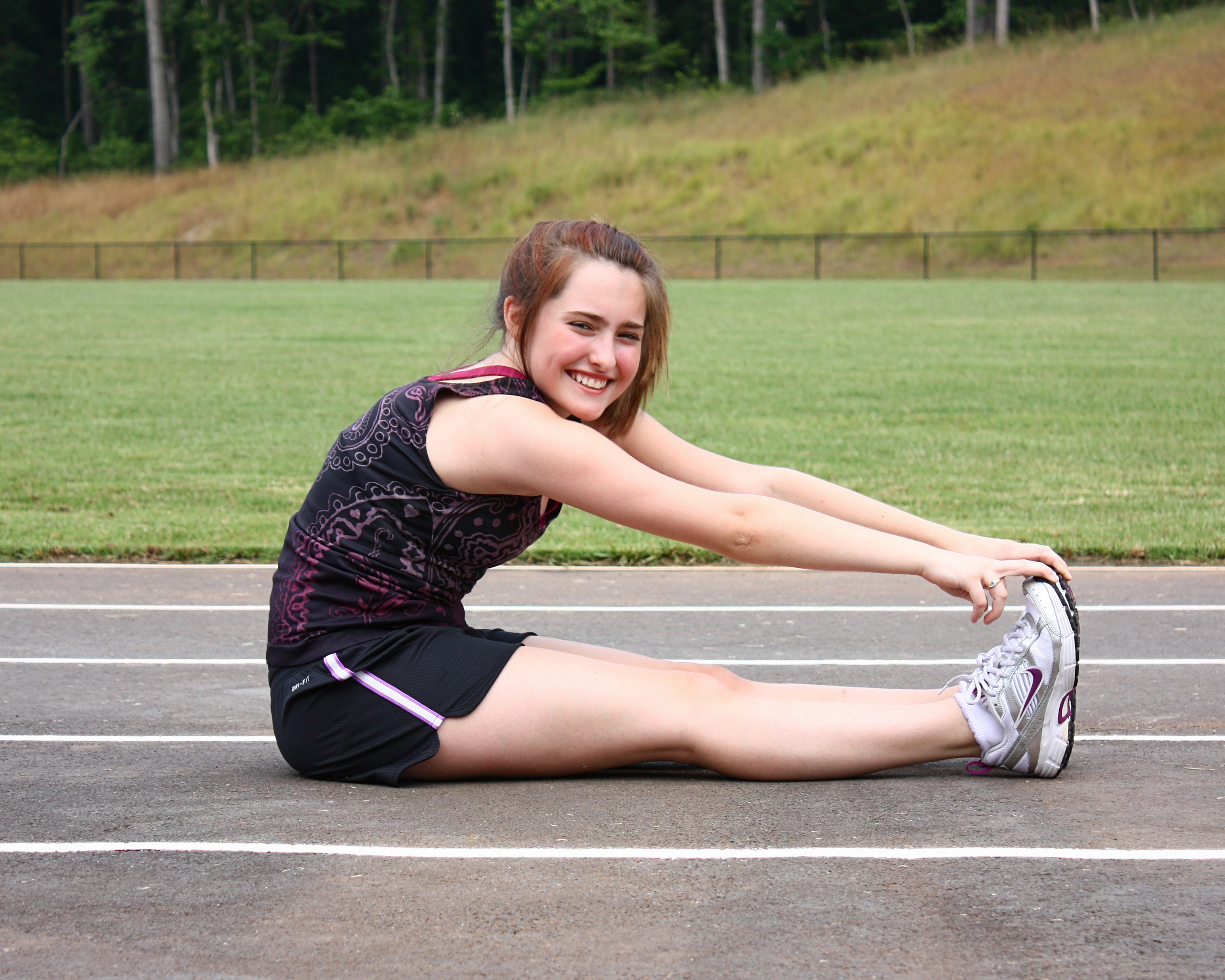 A cute young girl doing stretches, Beautiful, Tweens, Track, Teens, HQ Photo