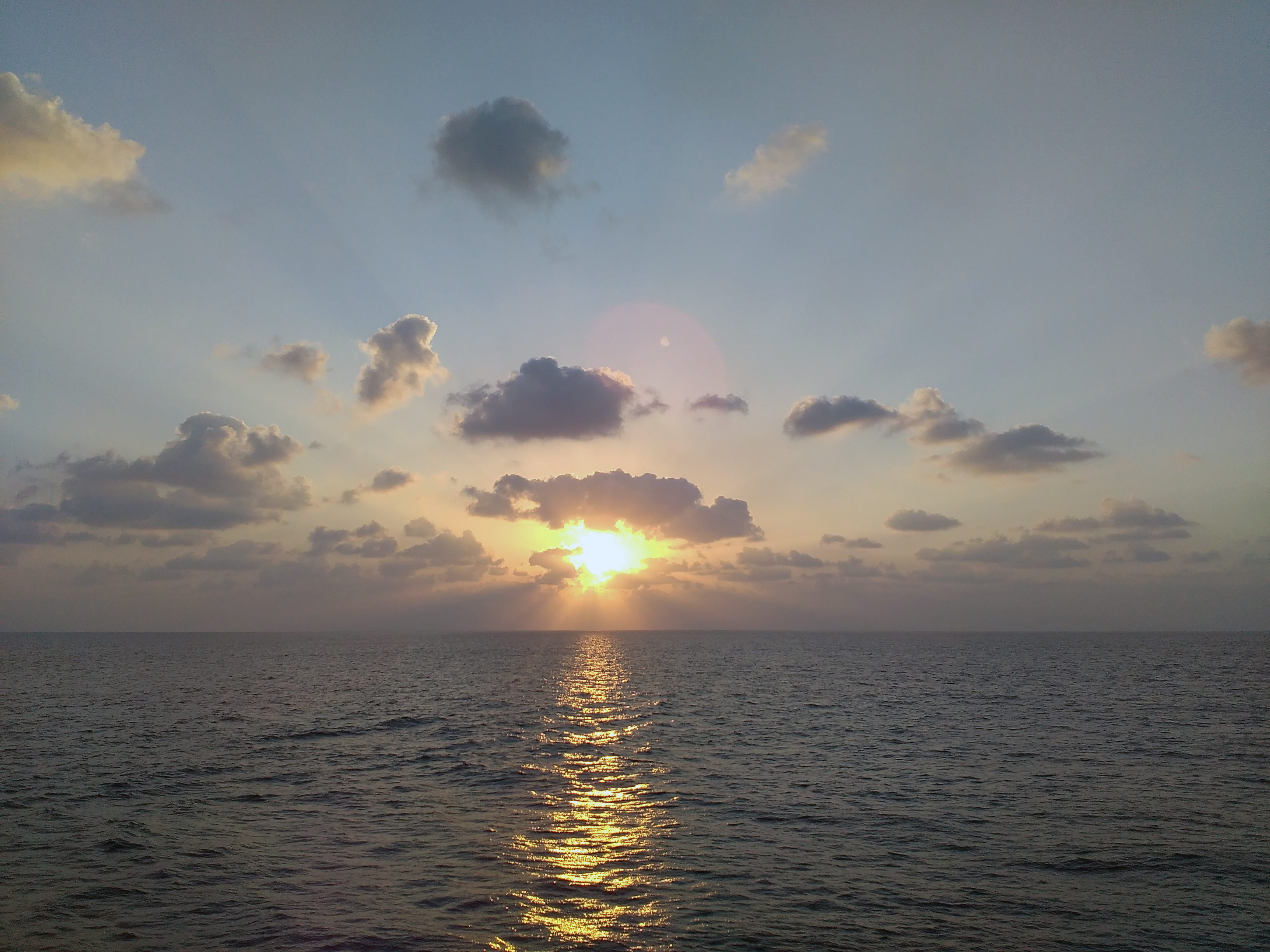 A sun set at midsea photo