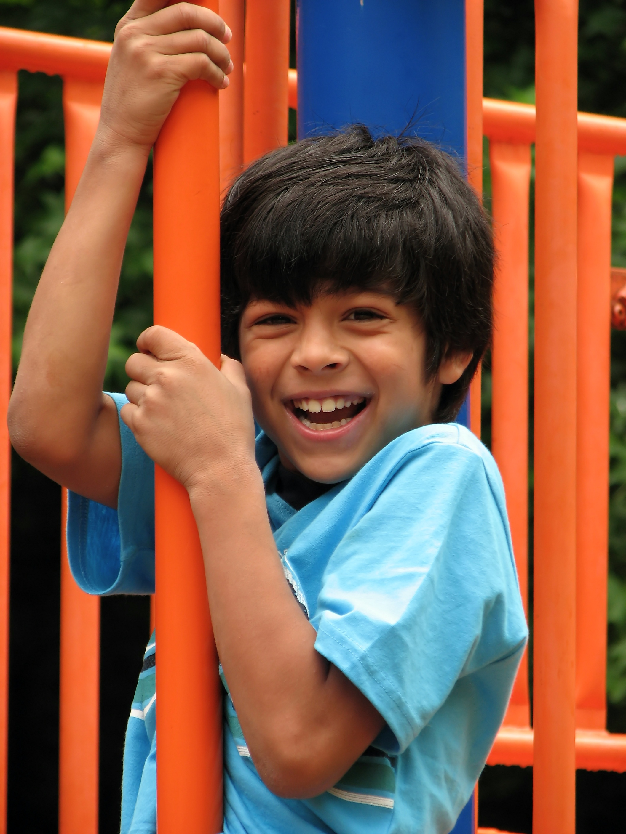A young boy playing on a playground photo