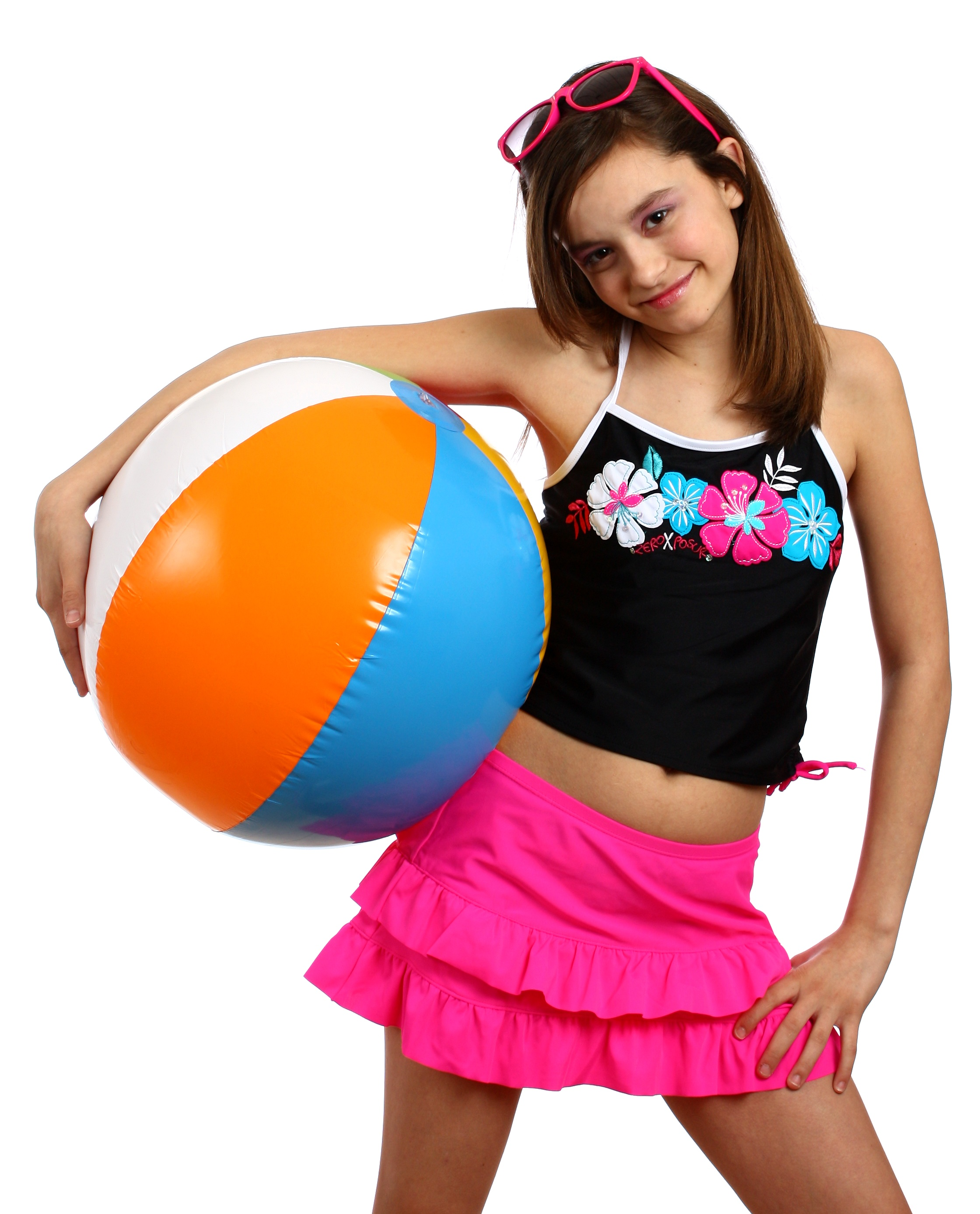 A young girl posing with a beach ball photo