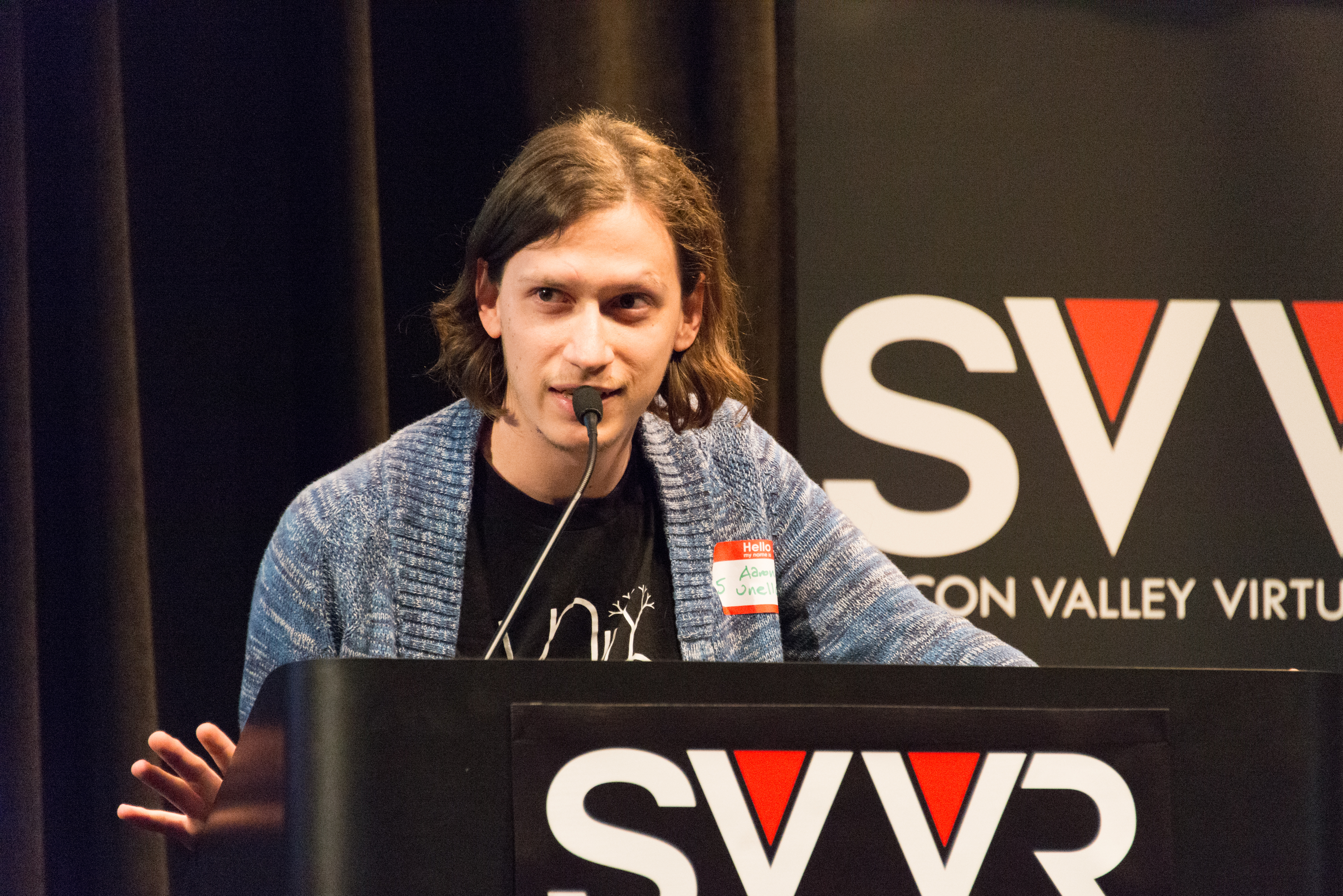 Aaron Lemke of Unello Design giving 60 Second Pitch at SVVR (right hand spread), Indoor, People, SVVR, HQ Photo
