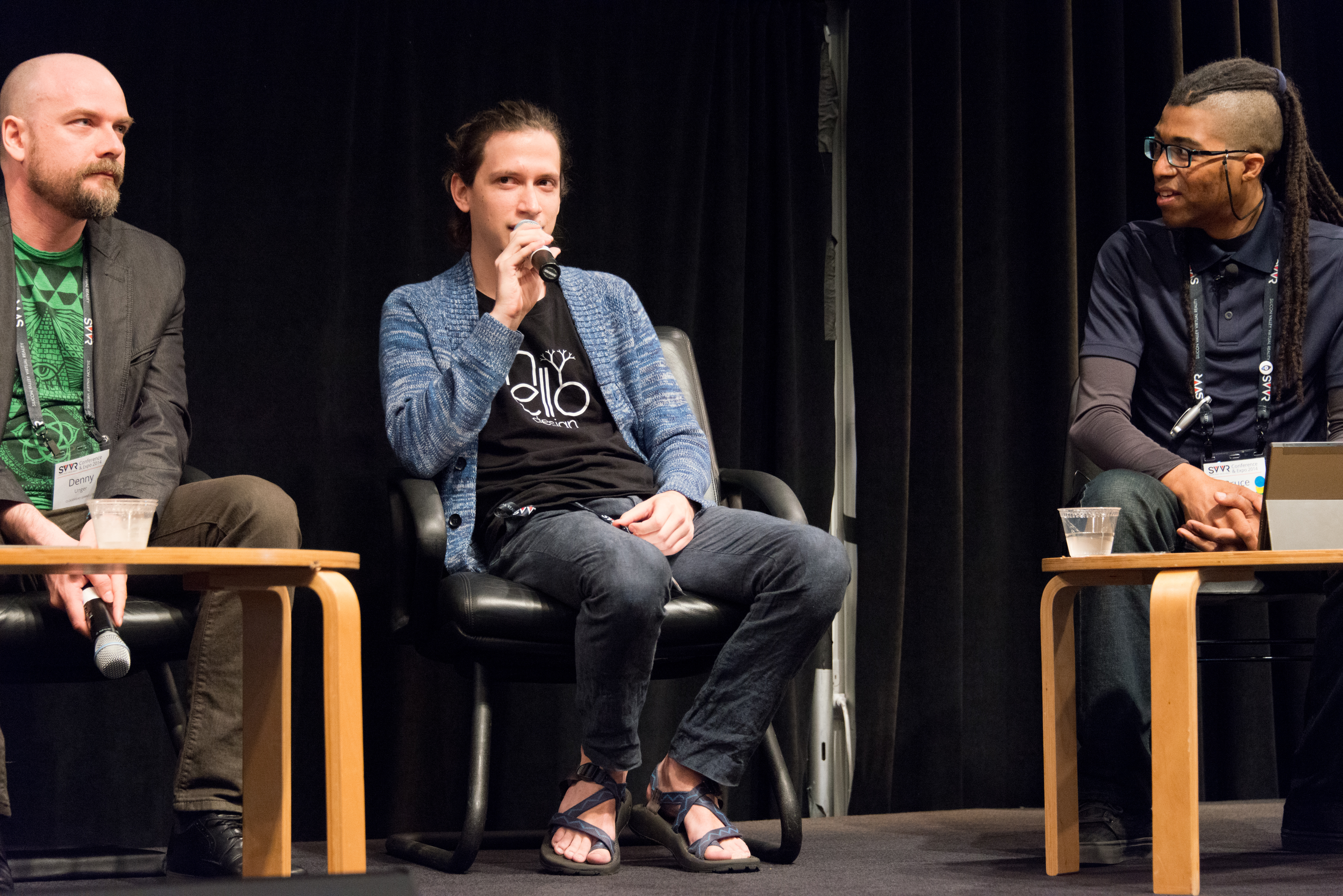 Aaron Lemke (Unello Design) discussing at indie dev panel at SVVR (full body view looking forward at audience with Denny Unger of Cloudhead Games on left and Cymatic Bruce on right), Indoor, People, Speaker, SVVR, HQ Photo