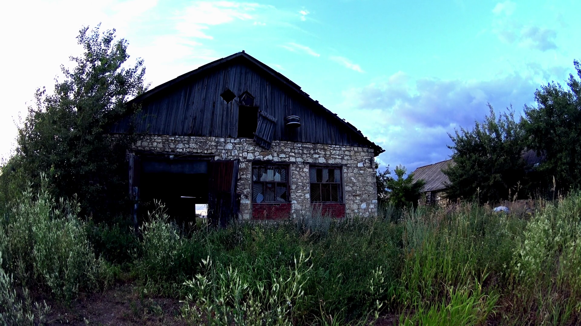 Abandoned house in grassy field Stock Video Footage - VideoBlocks