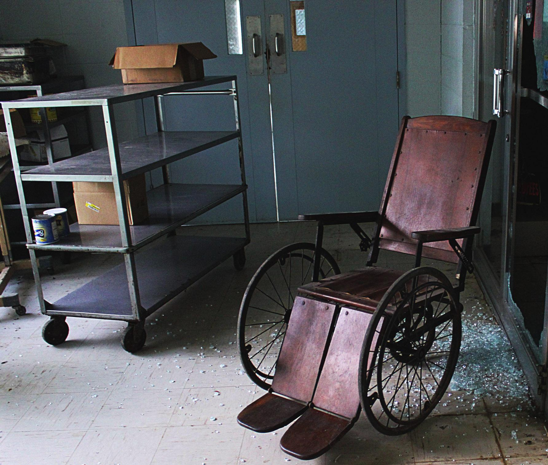 Awesome Old Wooden Wheelchair in Abandoned Hospital (OC) : abandoned