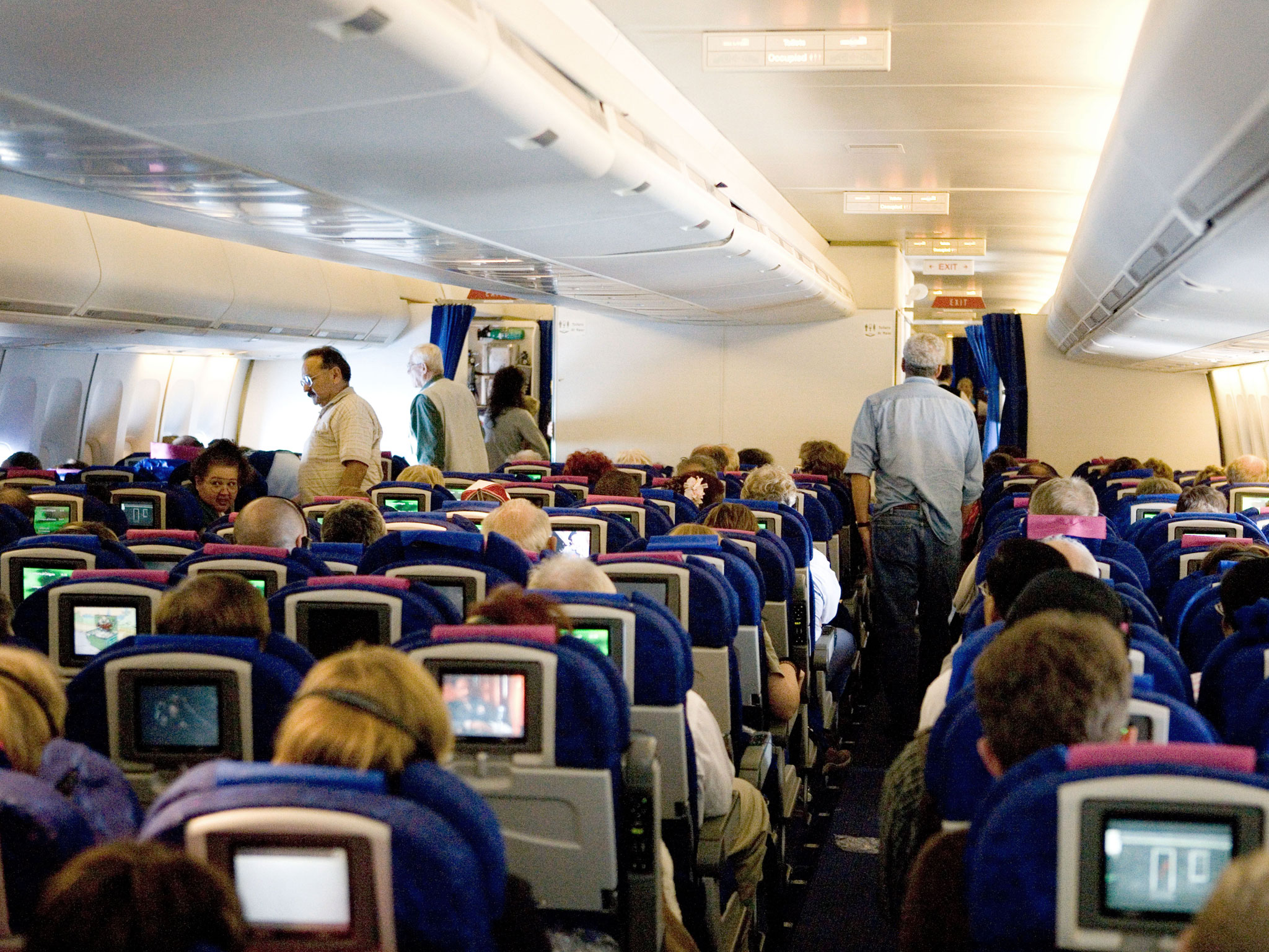 Why Flight Attendants Walk Airplane Aisles With Bug Spray - Condé ...