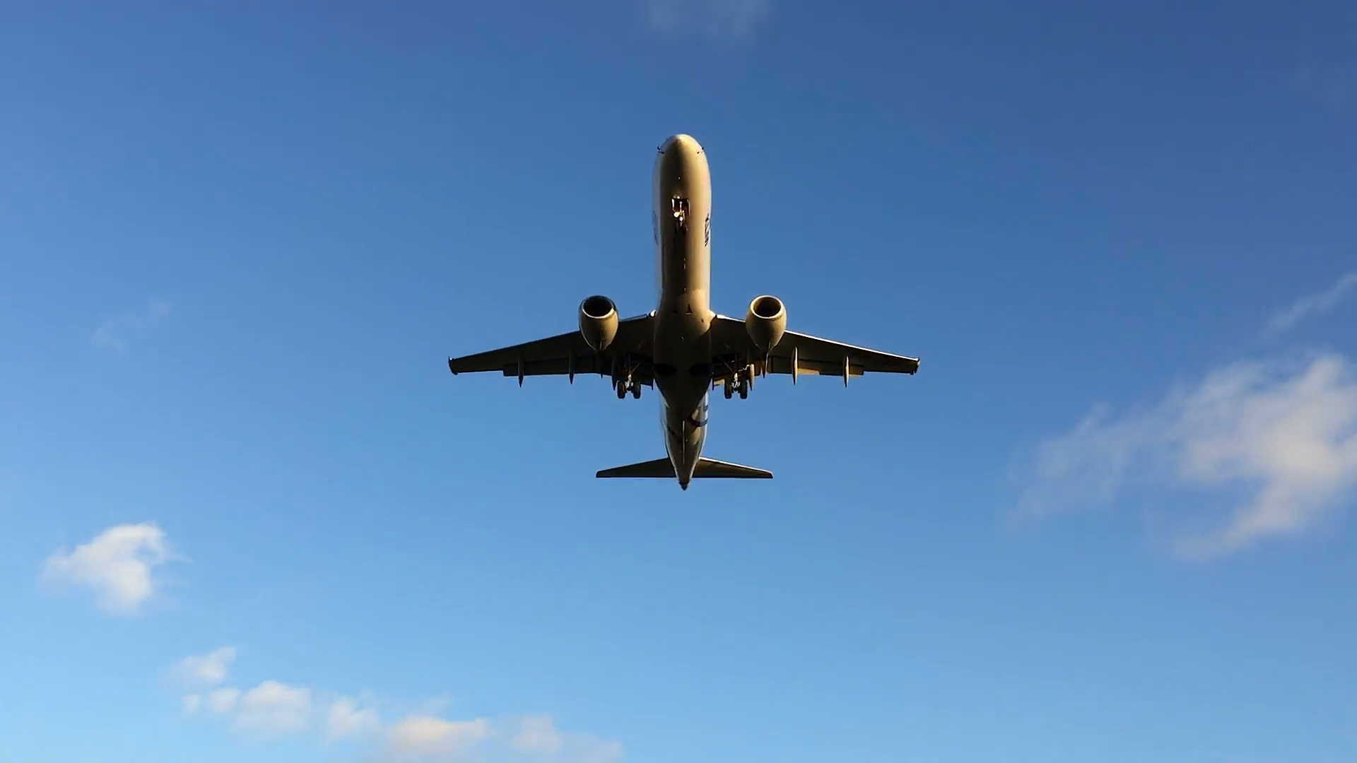Airplane flying overhead to land, close Stock Video Footage ...