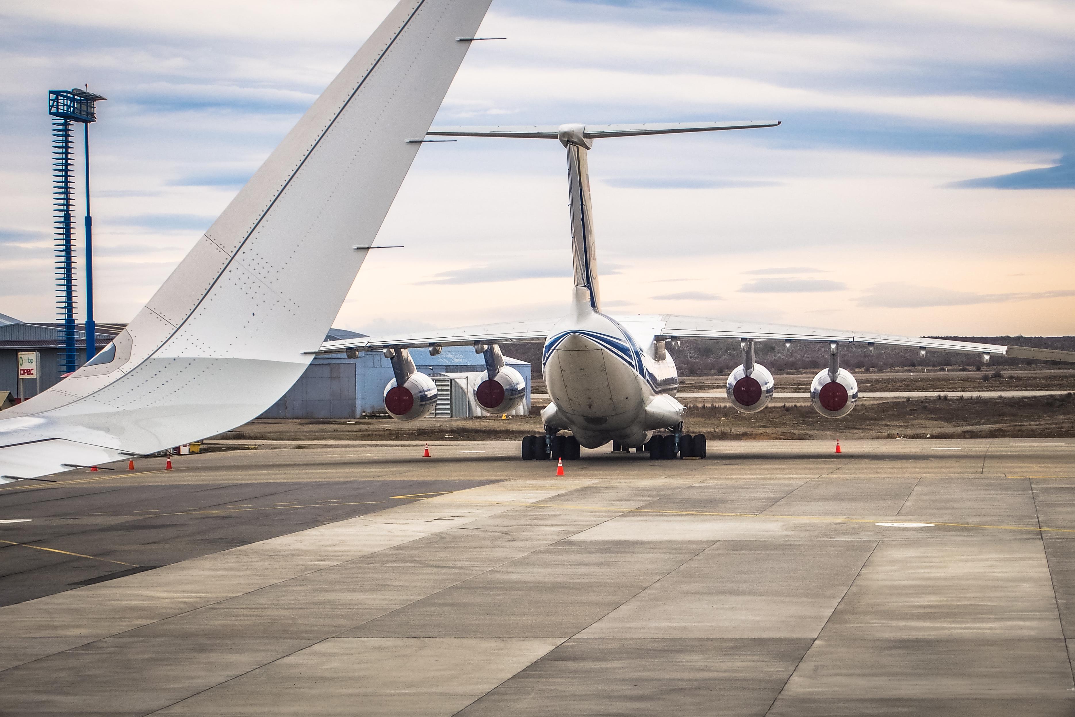 Airplane near the terminal in an airport photo