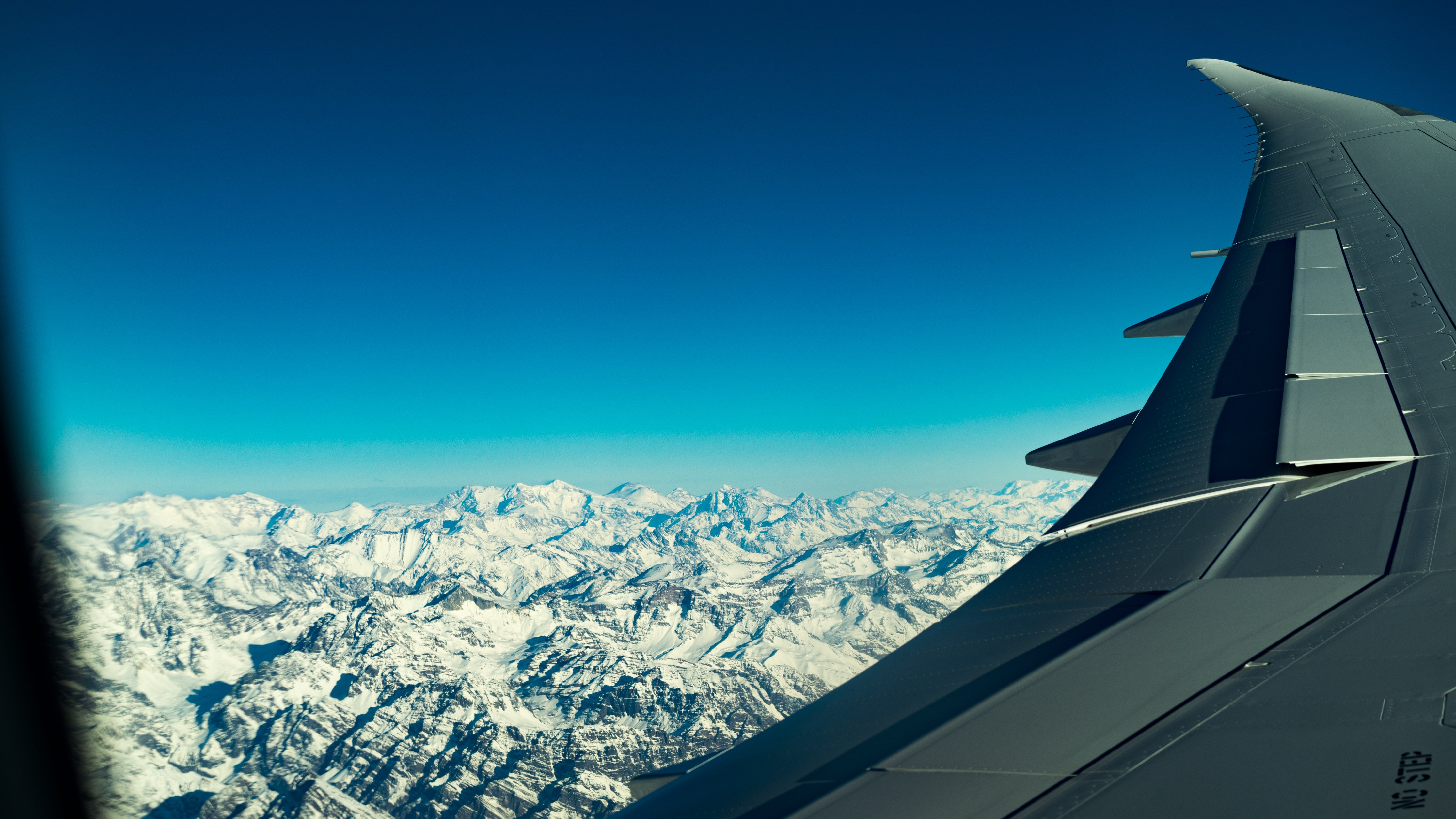 Airplane over mountains photo