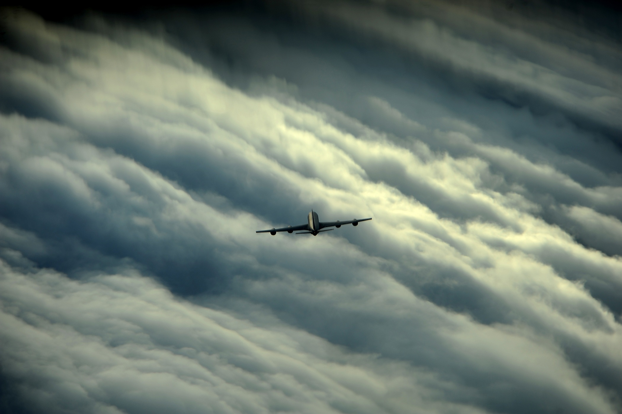 Airplane over the clouds photo