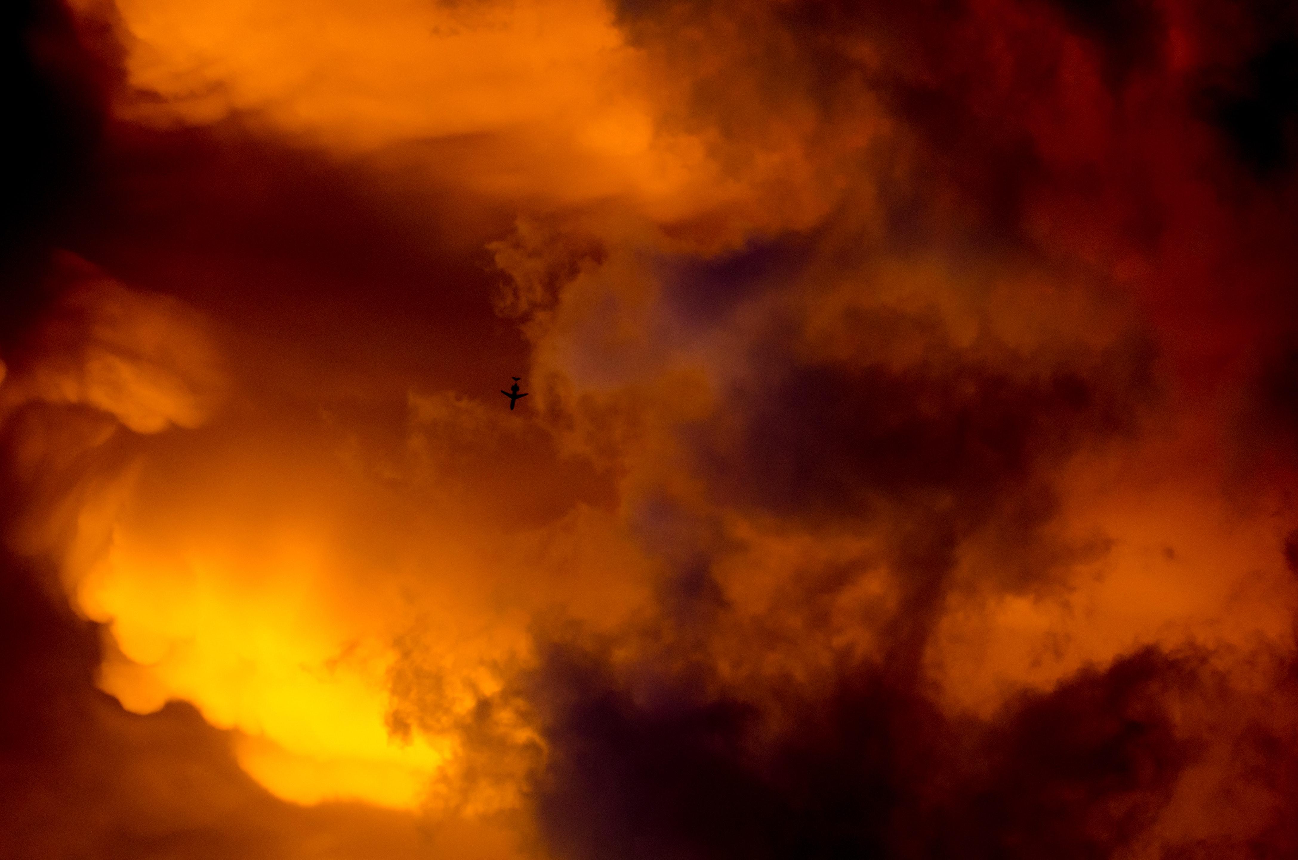 Airplane silhouette and orange sky photo