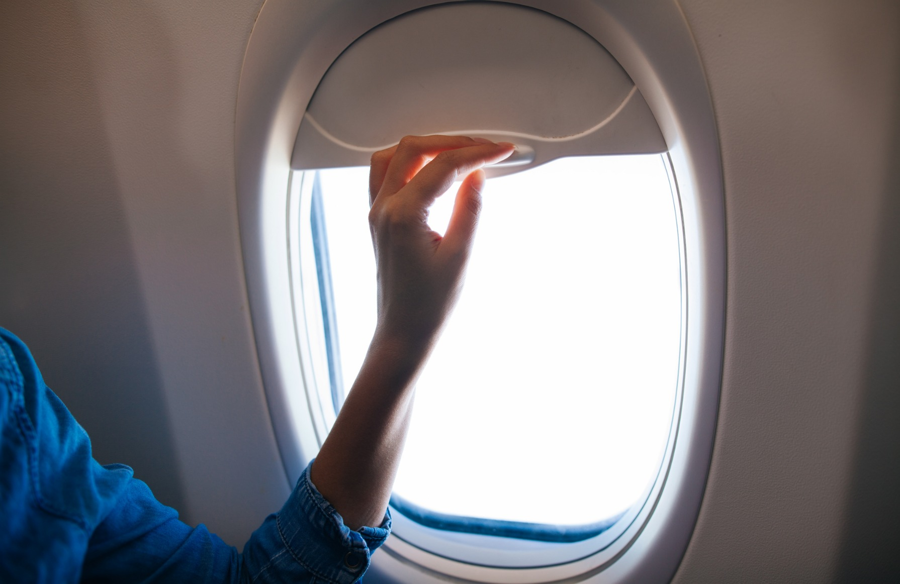 The Scary Reason Your Flight Attendant Tells You to Raise Your ...