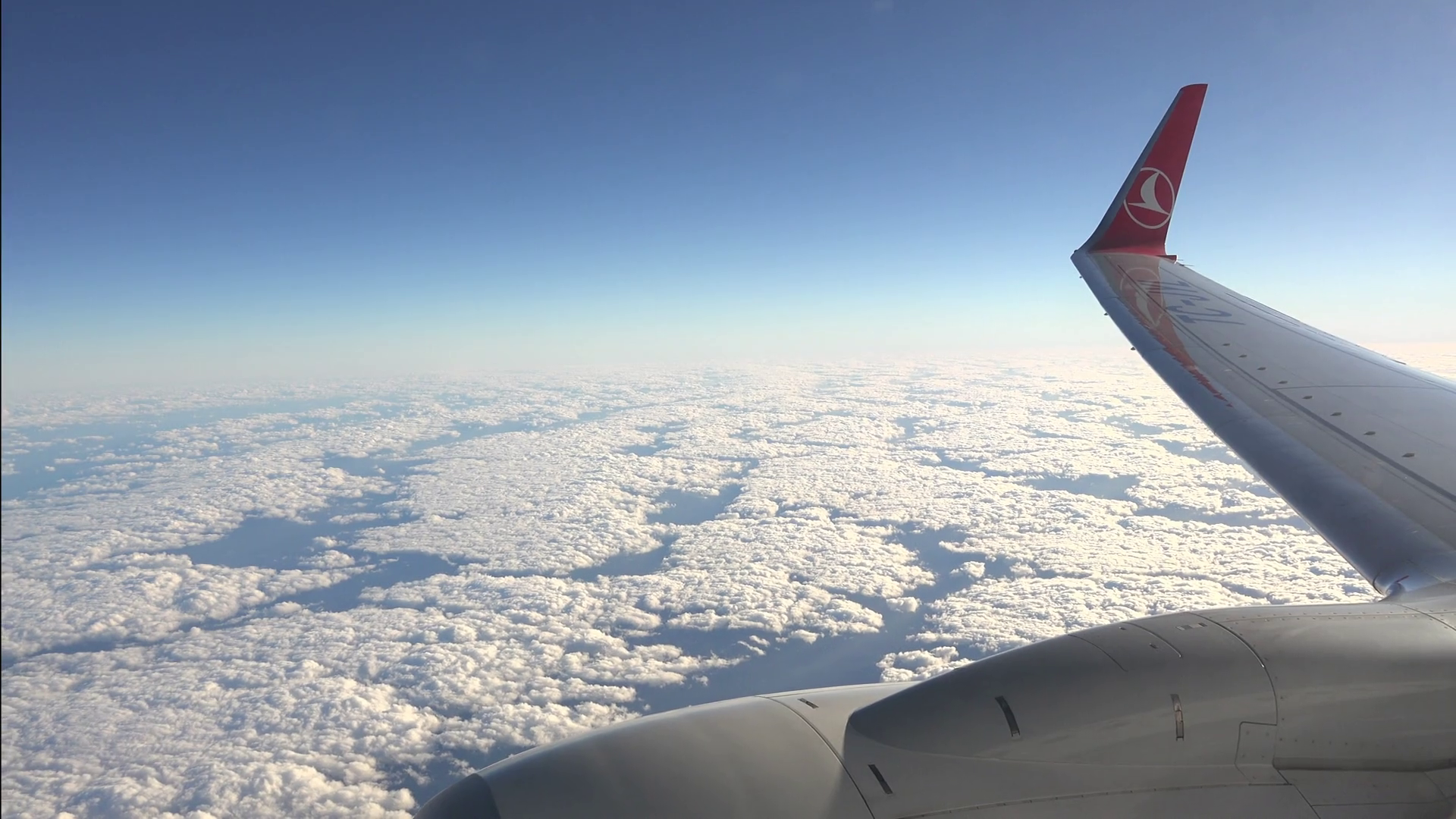 airplane wing and engine view from a flying plane Stock Video ...