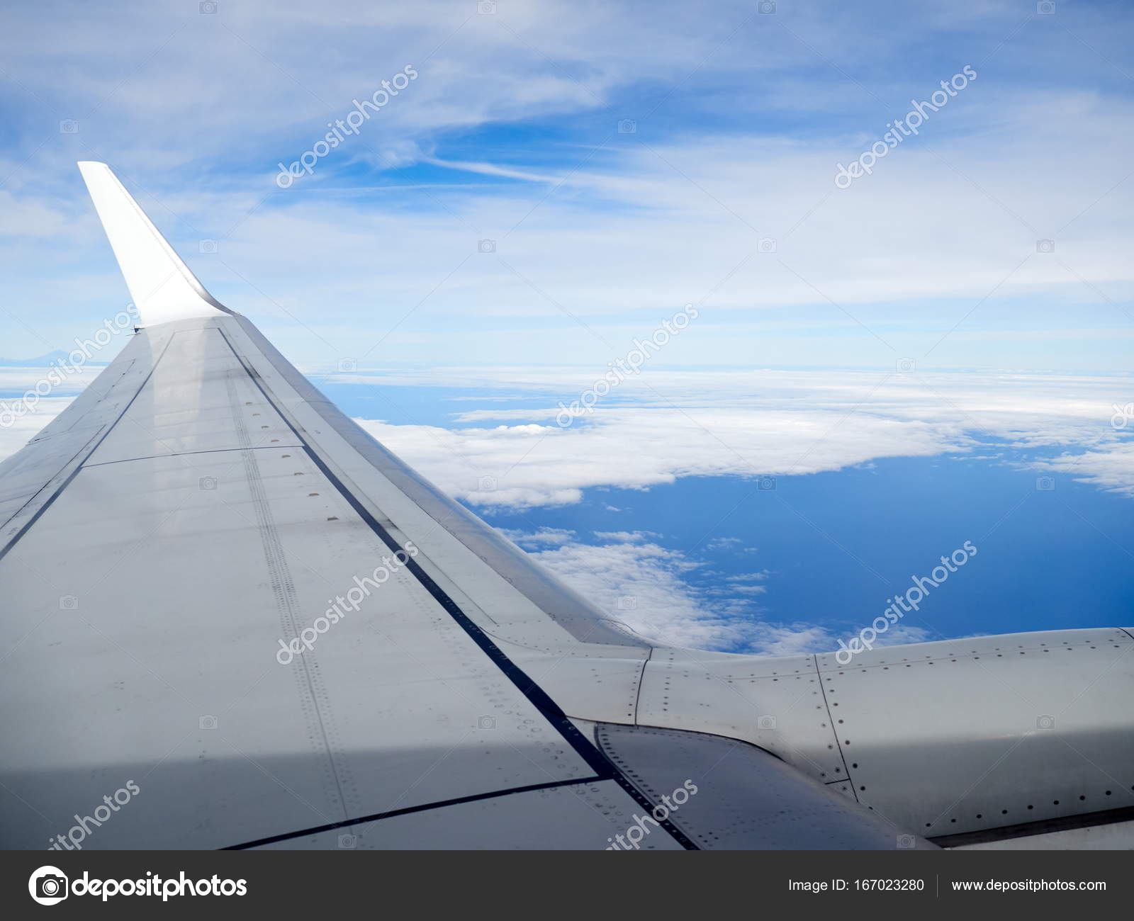Airplane wing and thick clouds photo