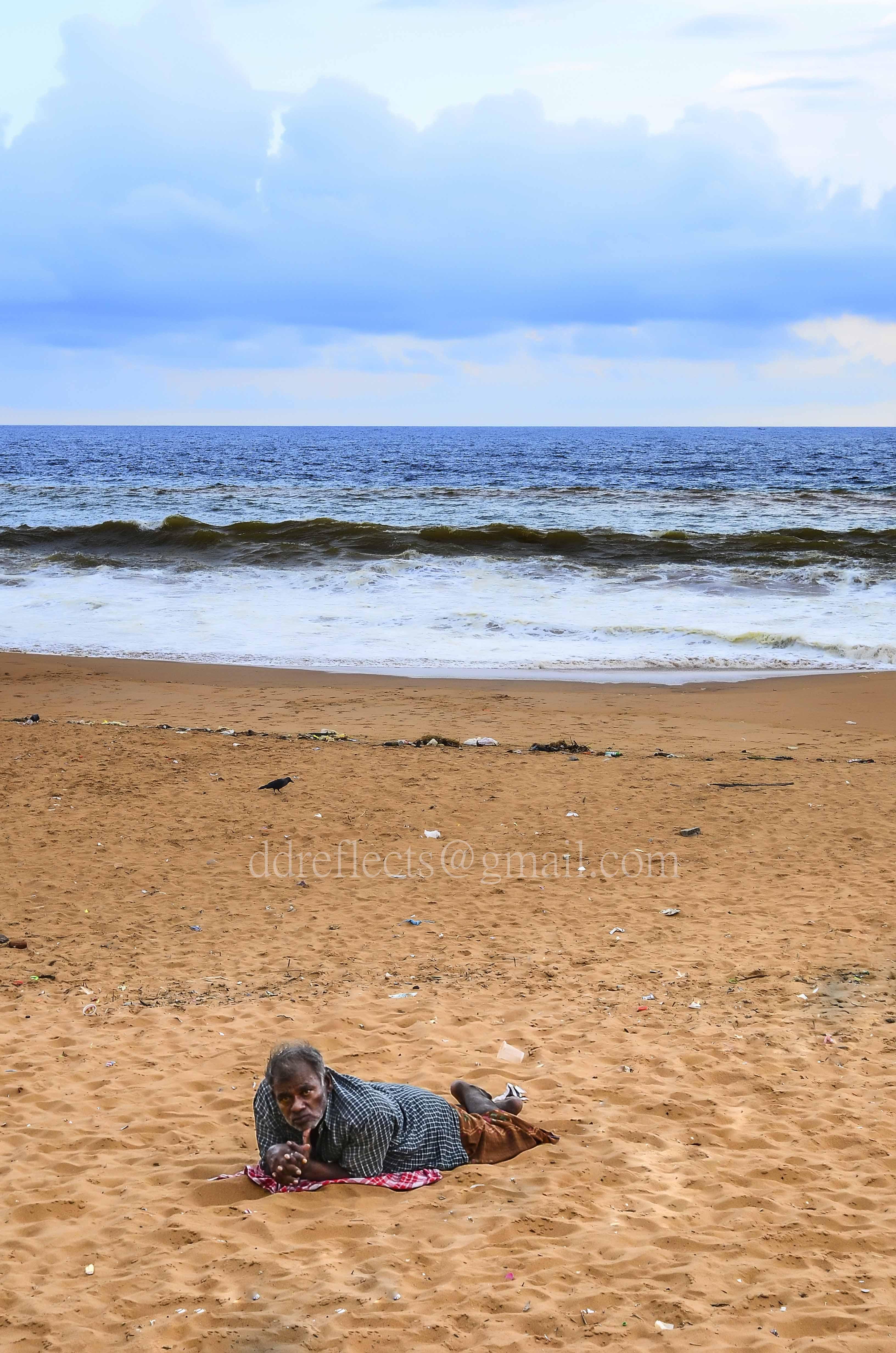 Alone man on the beach photo