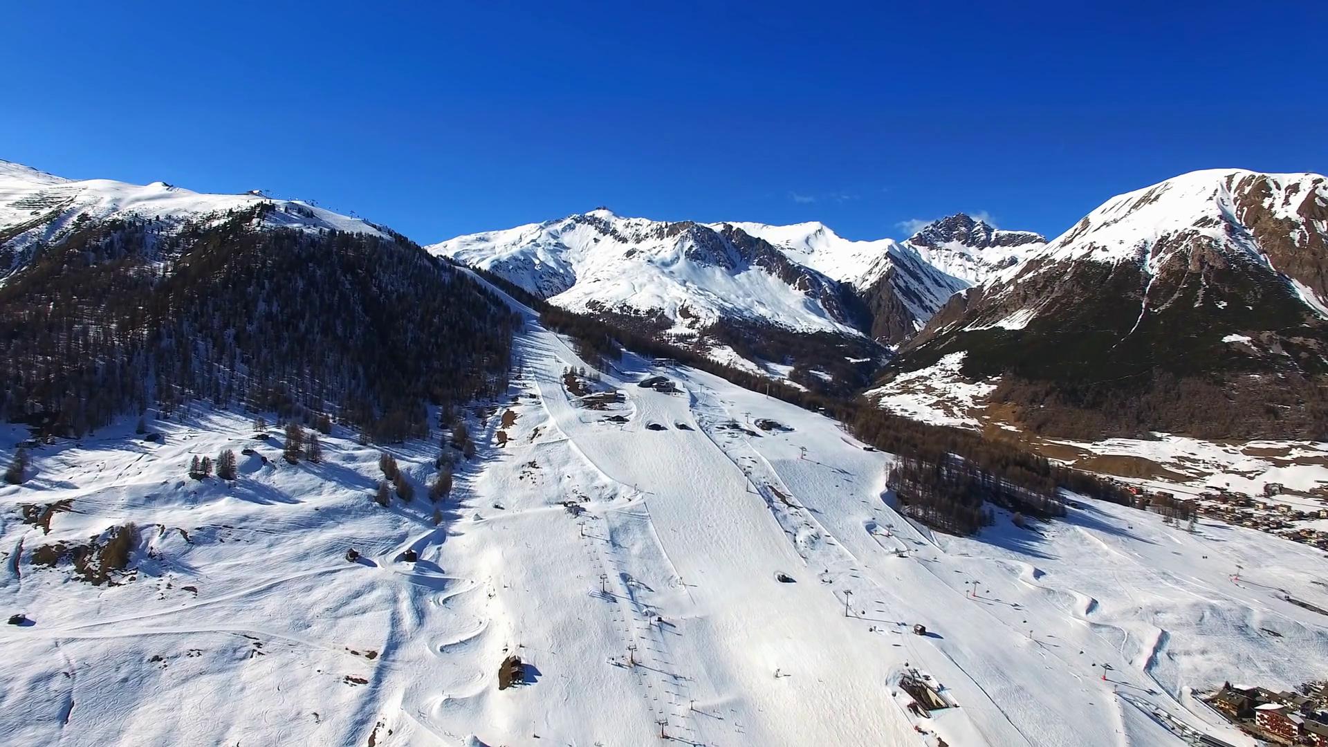 Aerial view of ski slope in Livigno alps ski resort in winter ...
