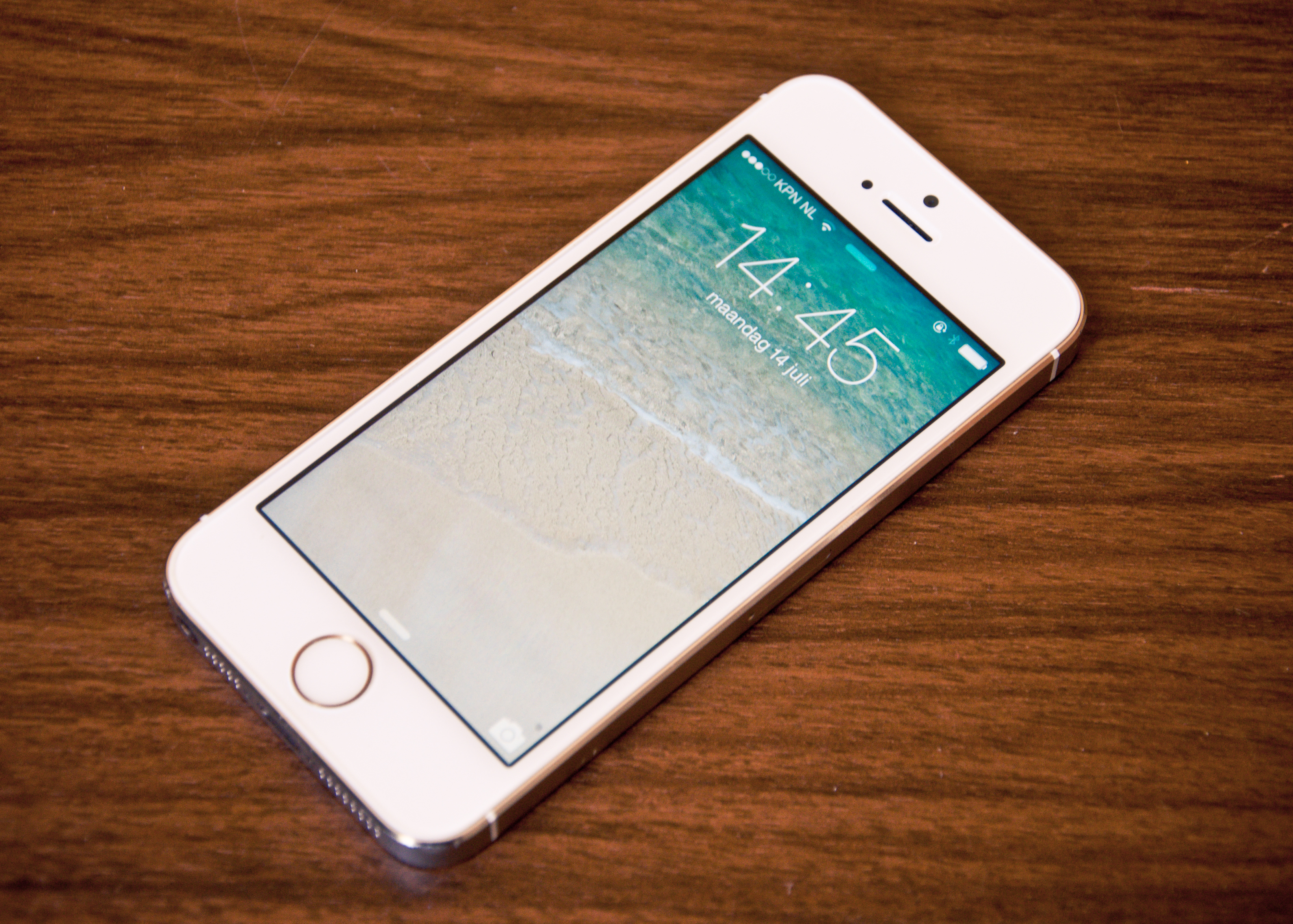 Free Photo An Iphone 5s On A Table New People Network Free