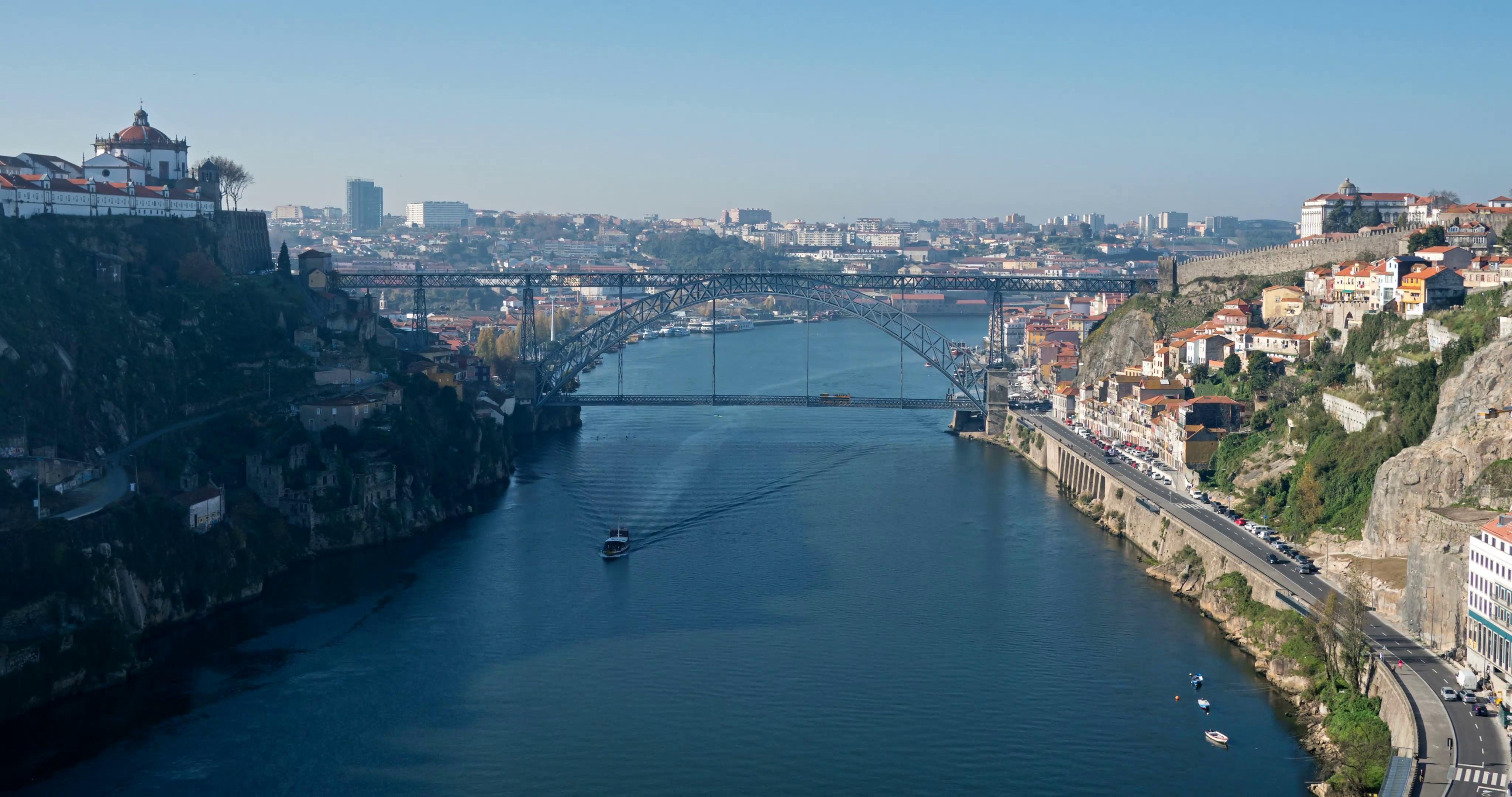Arrabida bridge and river traffic, Douro river, Porto, Portugal ...