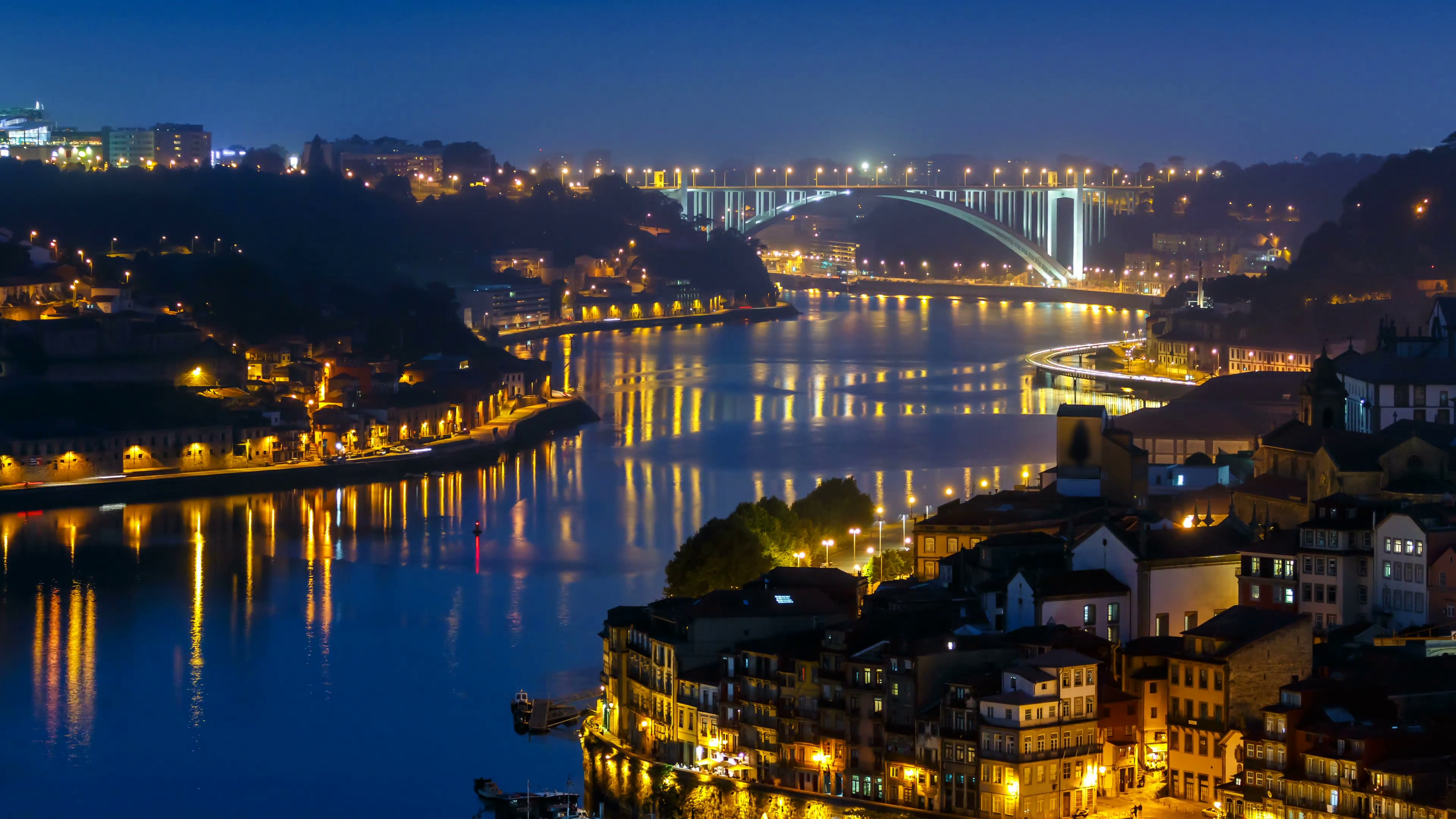 City of Porto and Gaia from evening to night by the Douro river ...