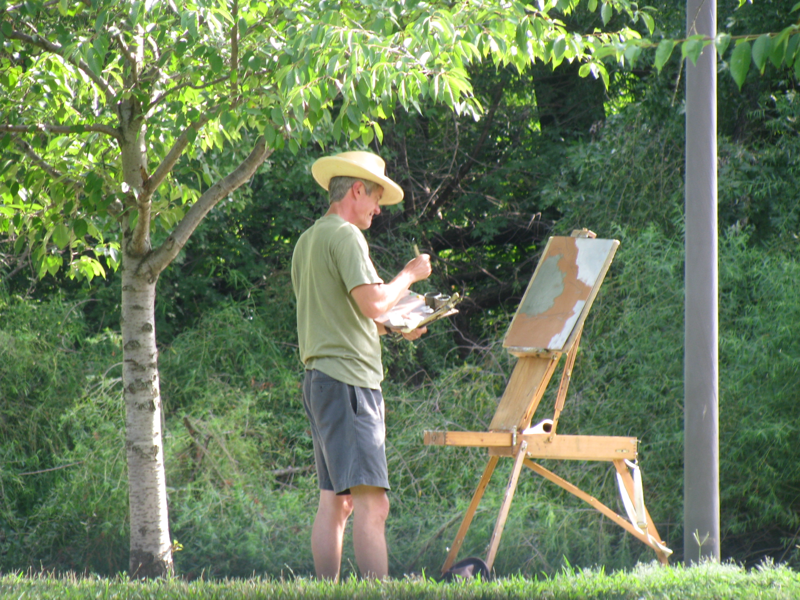 Artist painting landscape photo