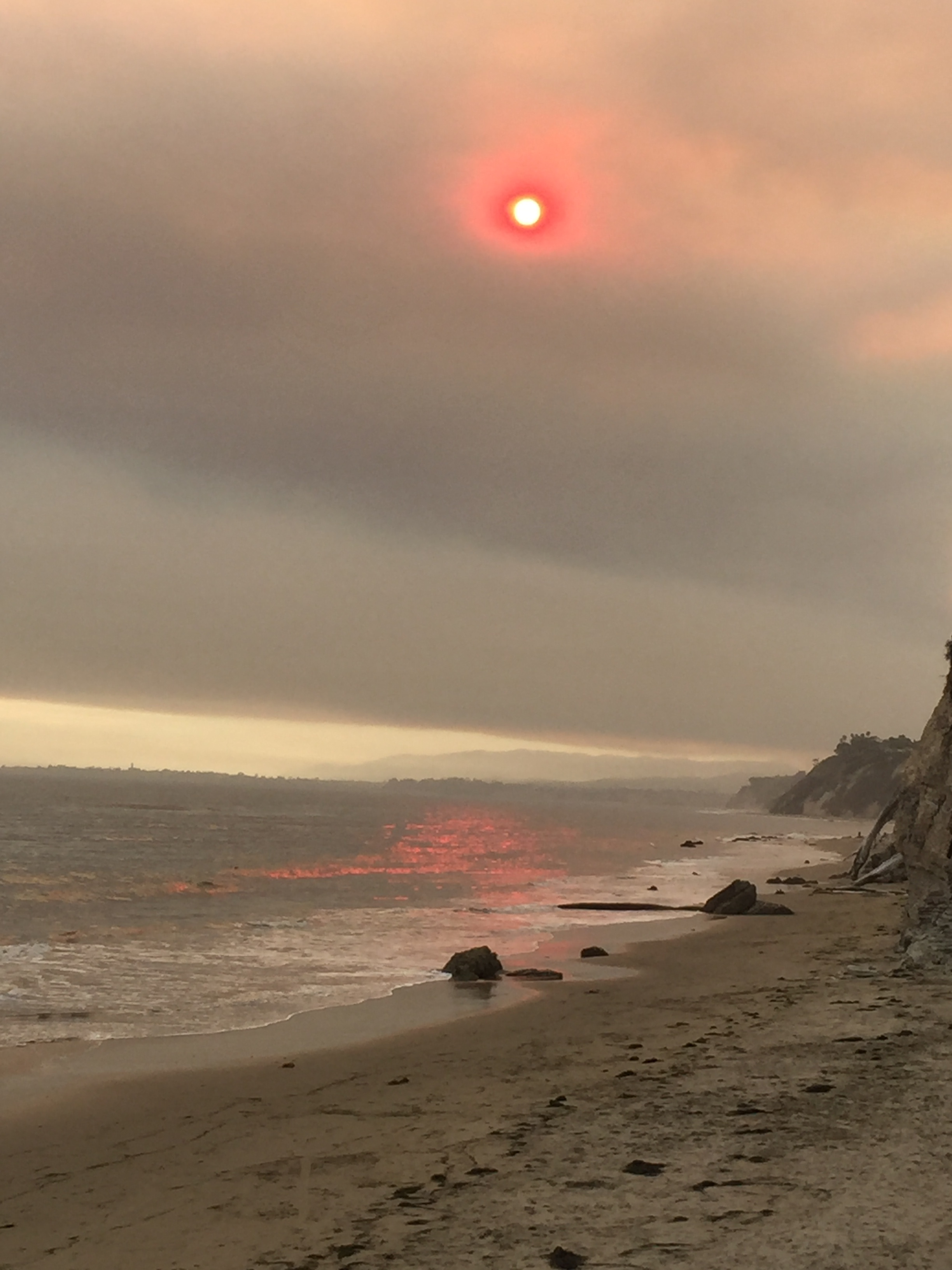 Smokey View of the Sun at the Beach | Weather Picture of the Day