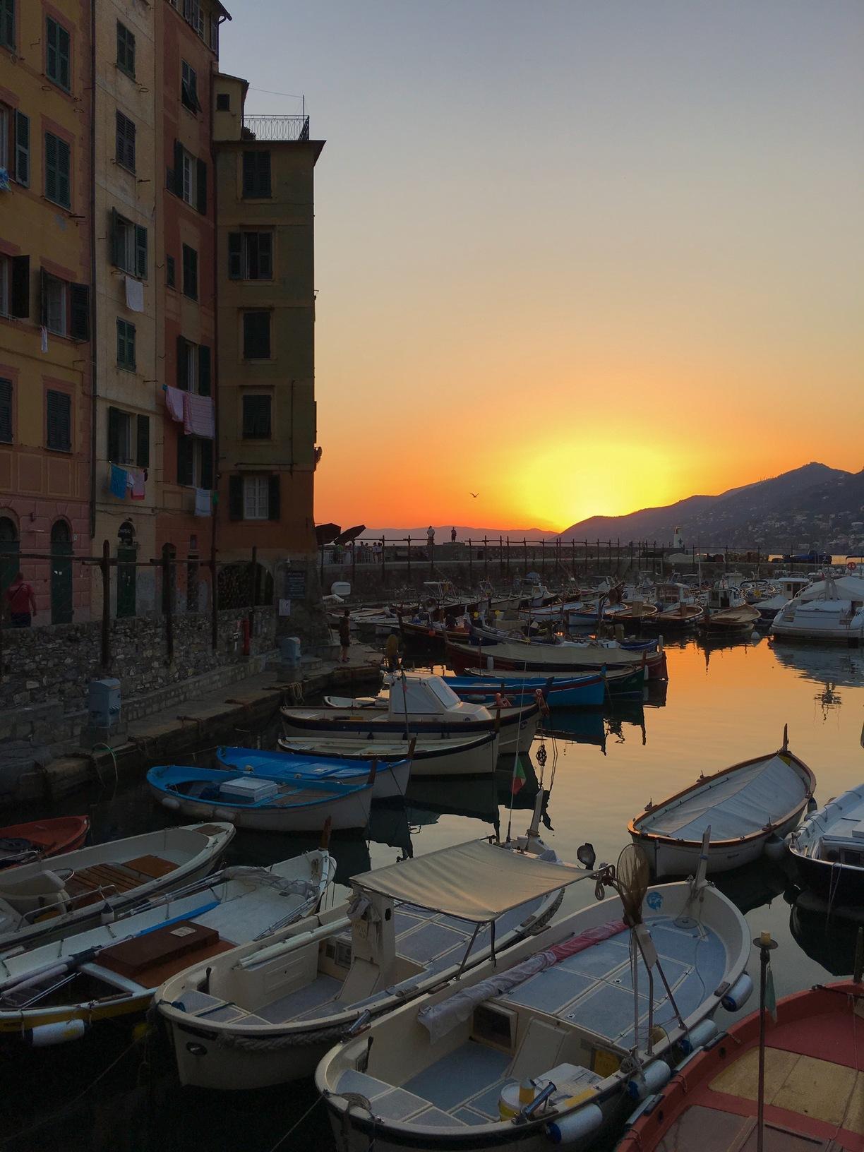 Camogli, Camogli, Italy - Sun goes down at the harbour of Camogli,...