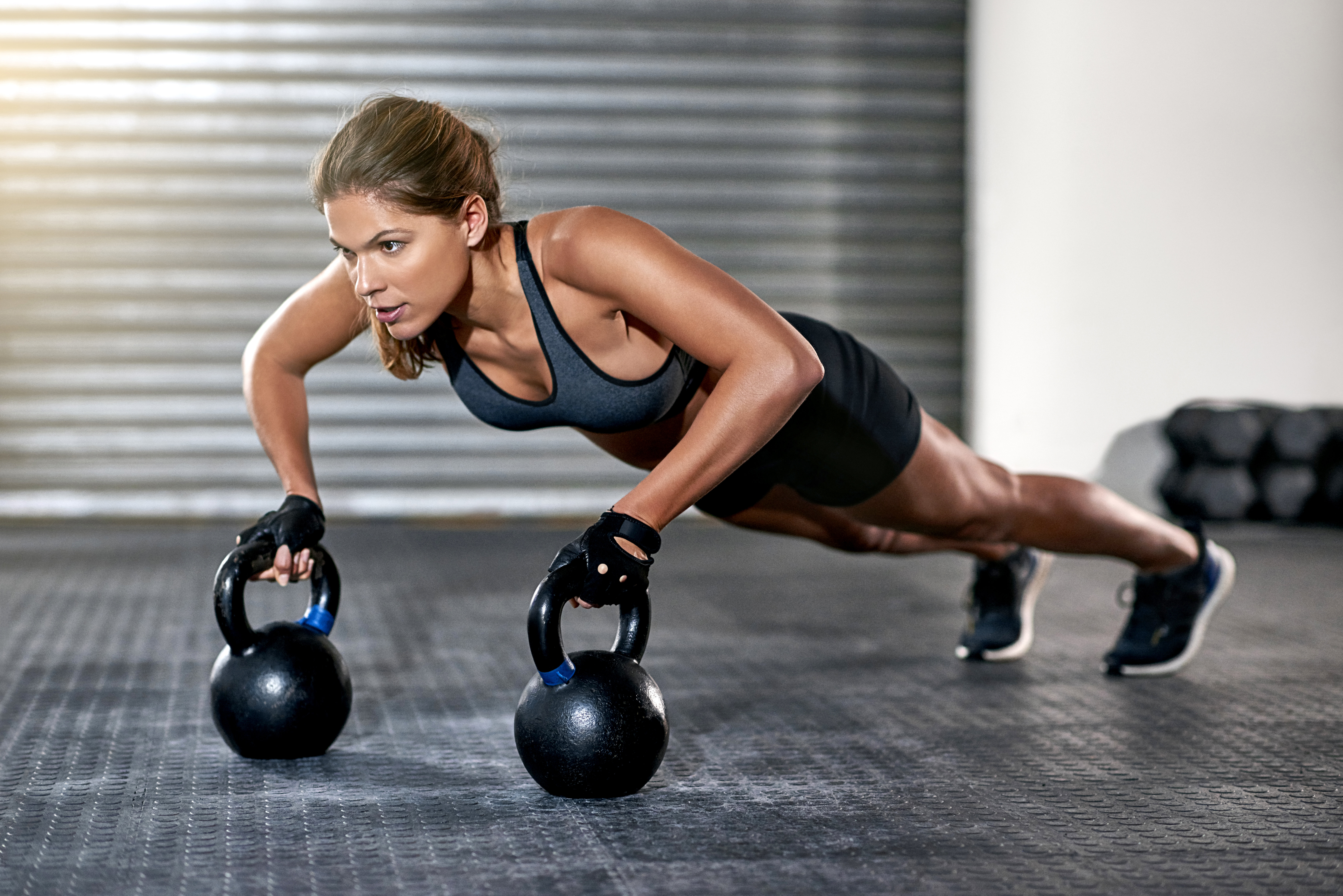 Home   Healthyou   Athletic Woman With Kettlebells