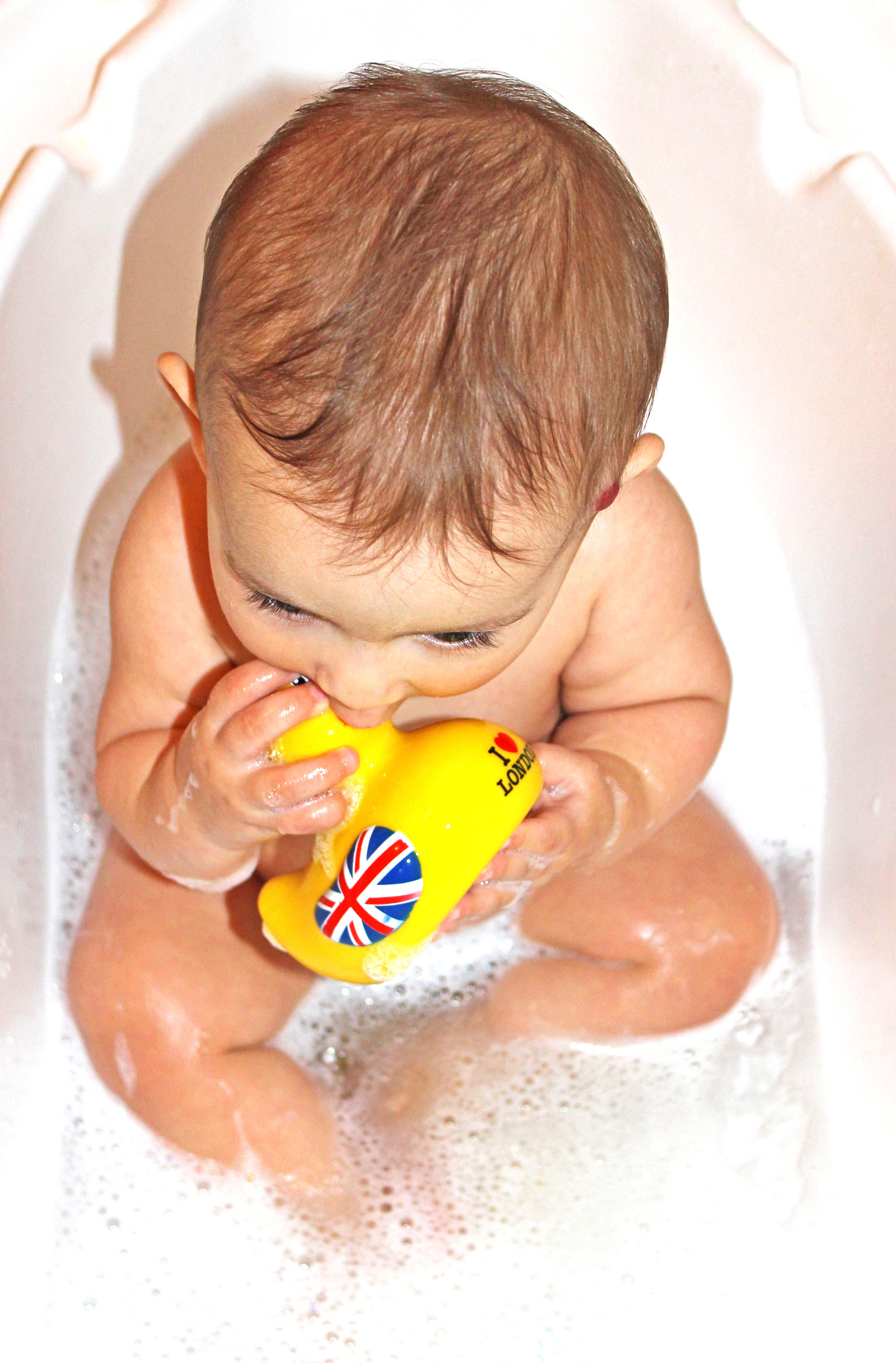 Baby bath with yellow duck toy photo