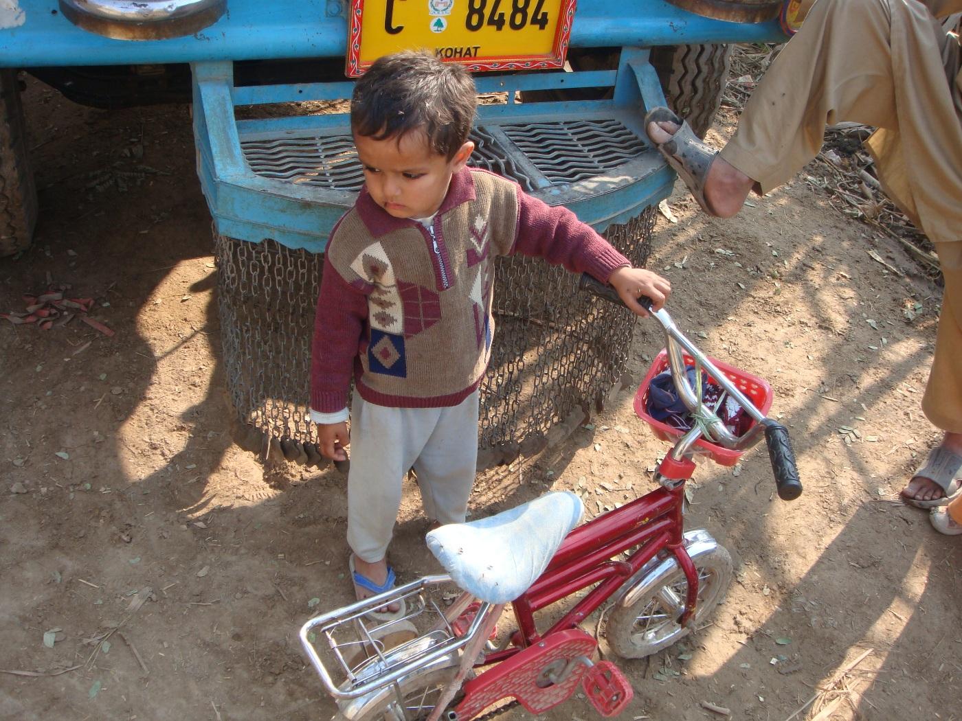 Baby boy with bike photo
