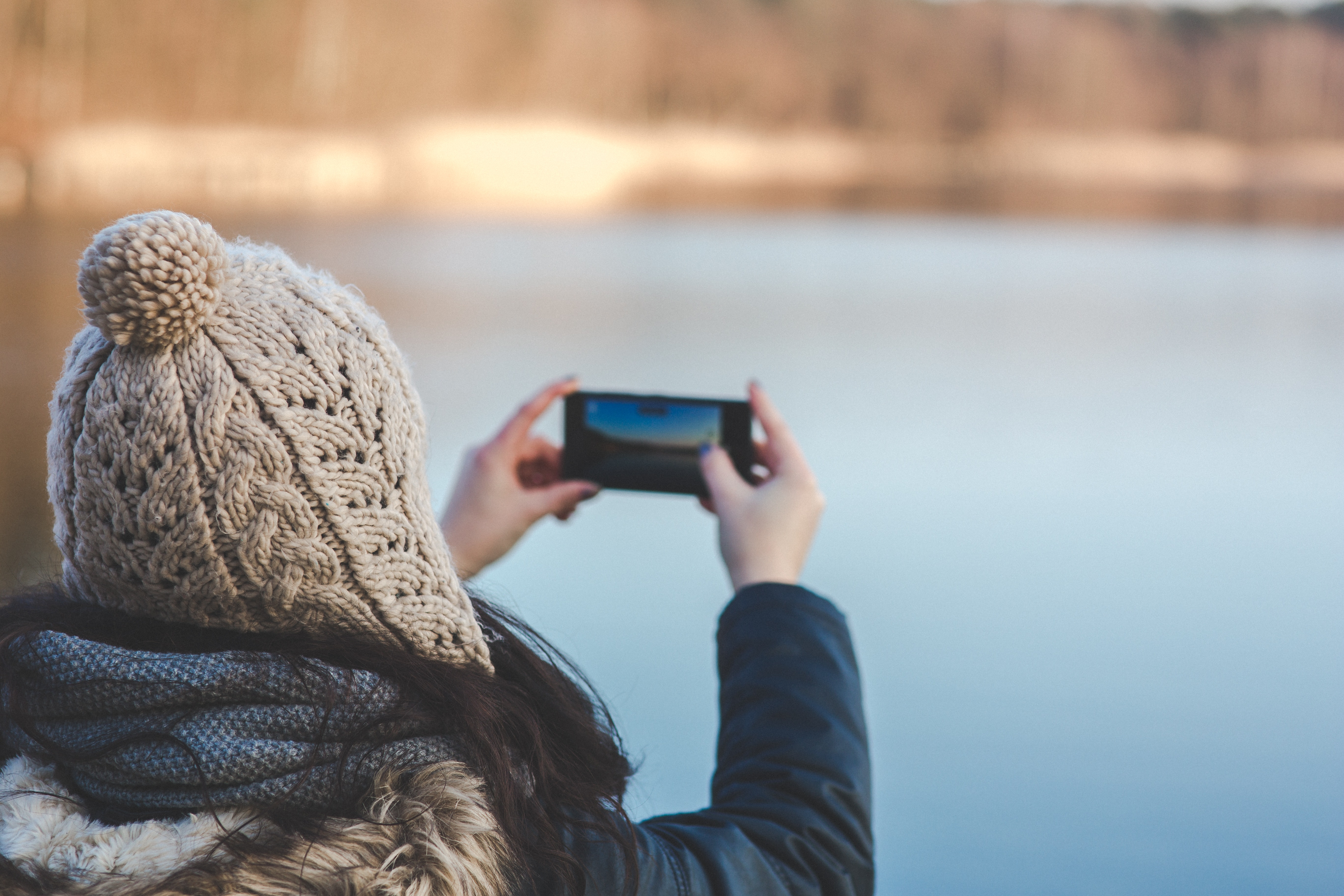 Back view of a woman taking photo with a smartphone, Cell, Girl, Hands, Hat, HQ Photo