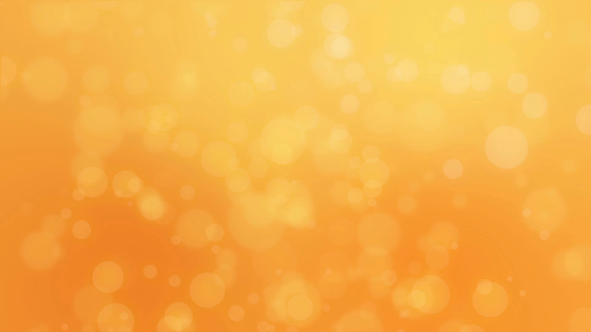 Bokeh holiday background with floating particles against a golden ...