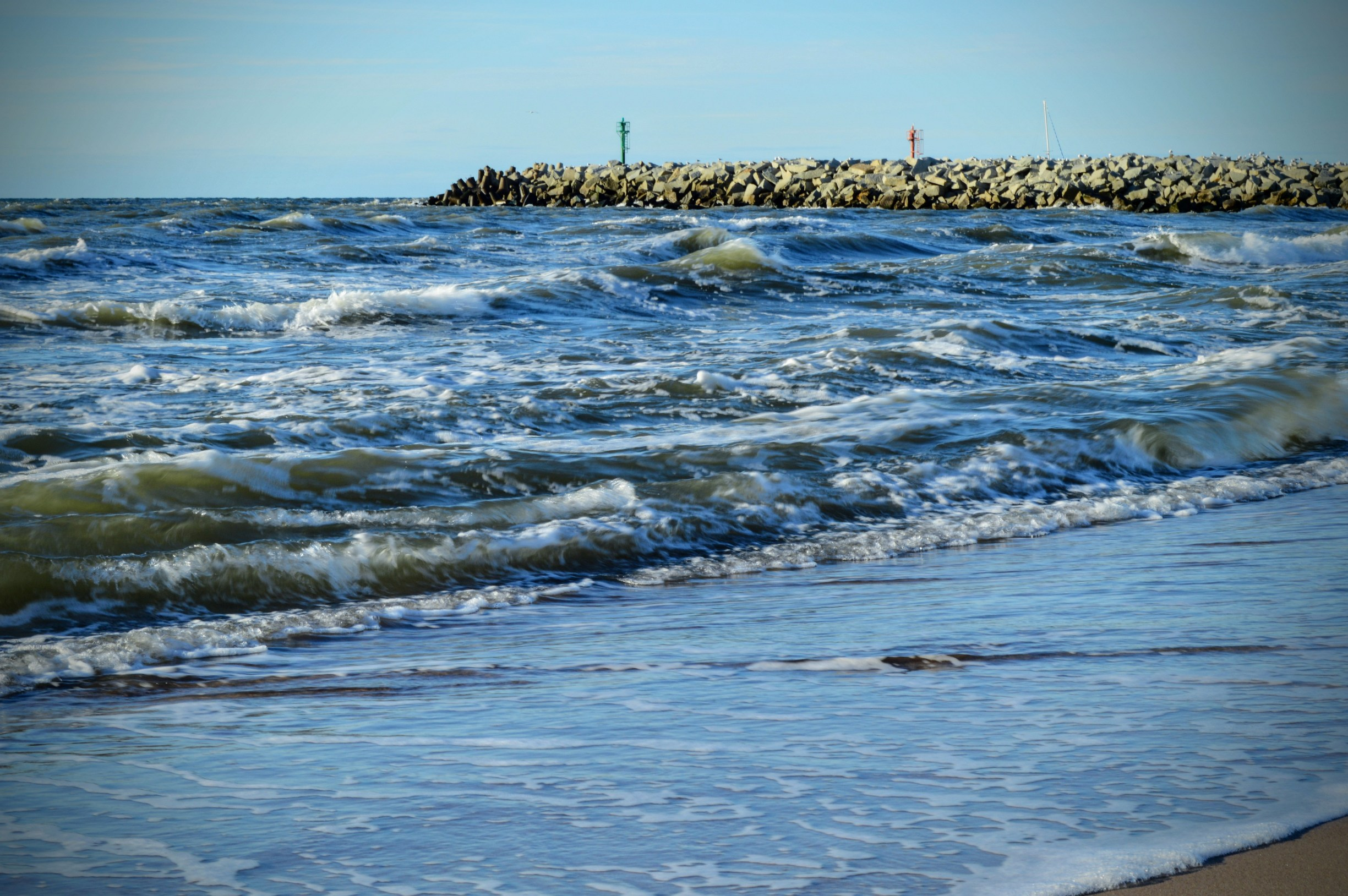Baltic sea coast with waves and a breakwater photo