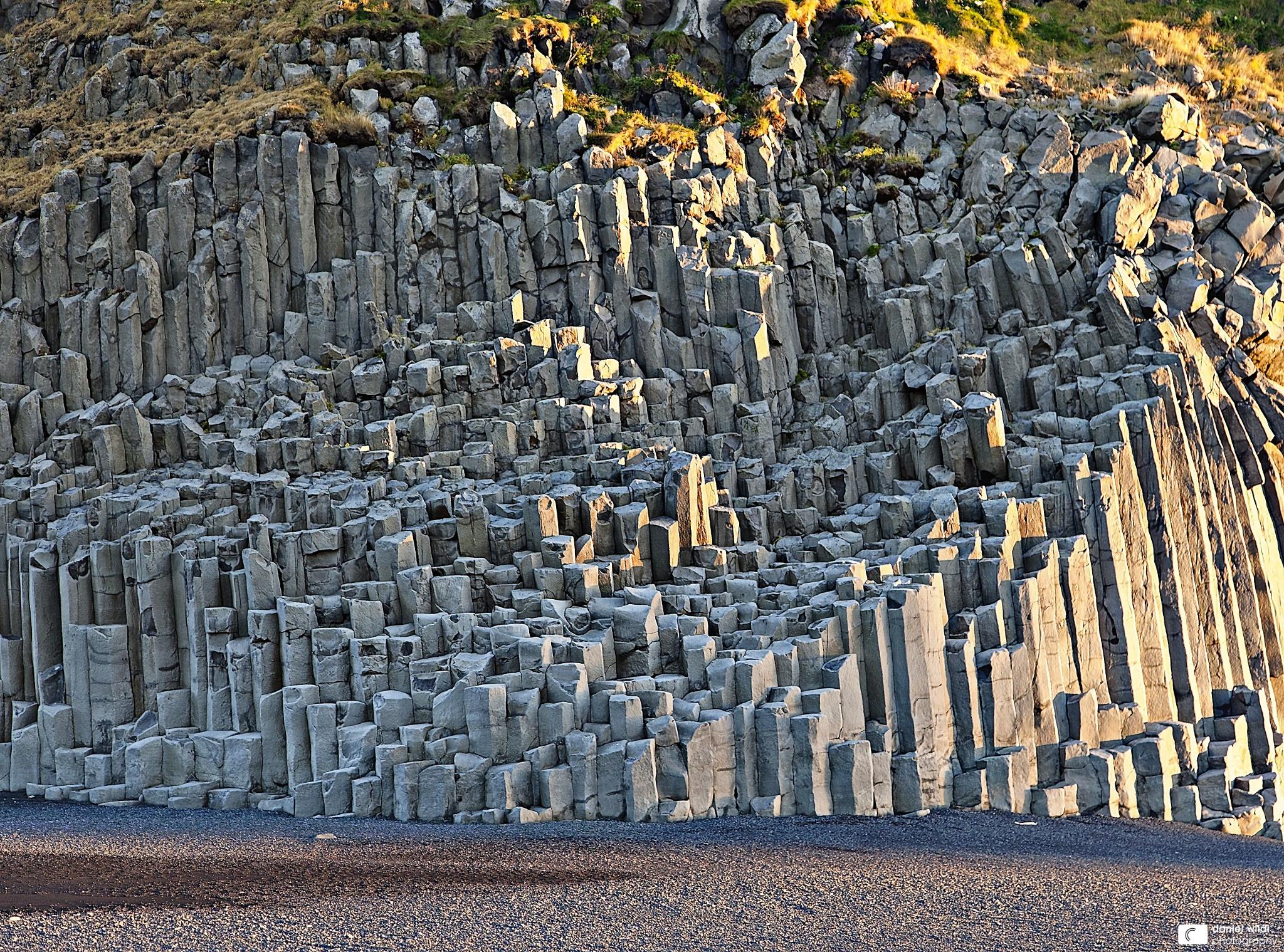 Basalt columns at the beach of Vík í Mýrdal Basalt is a common ...