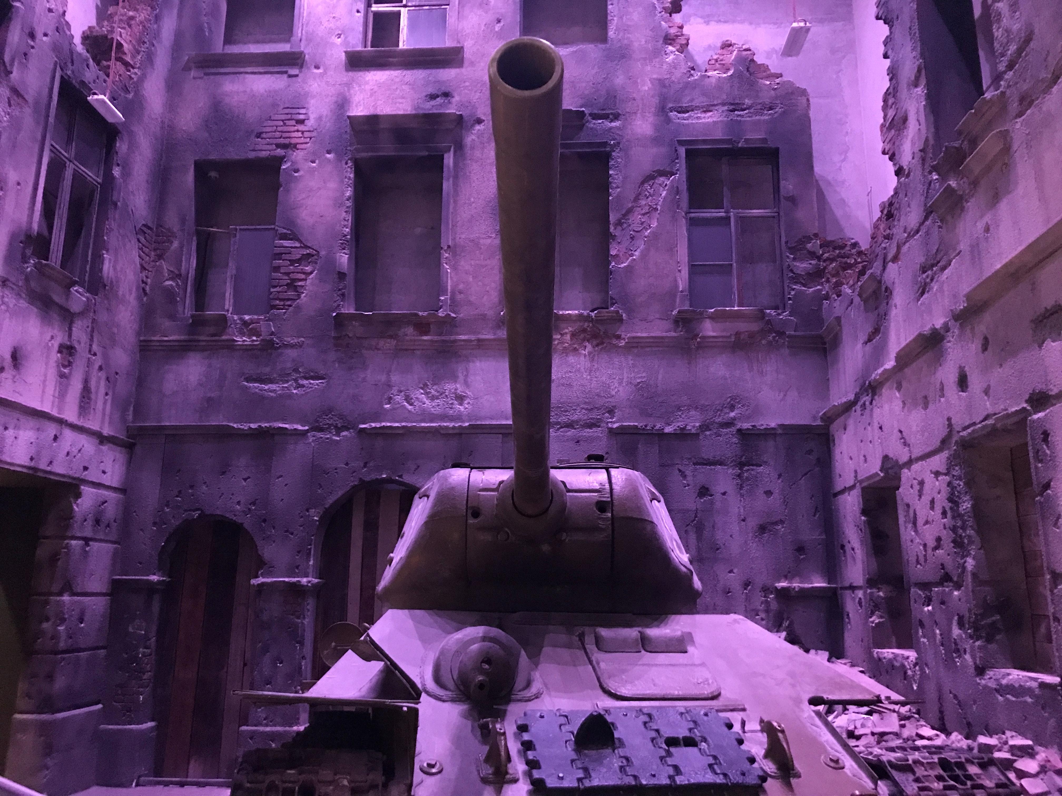 Battle tank near concrete structures photo