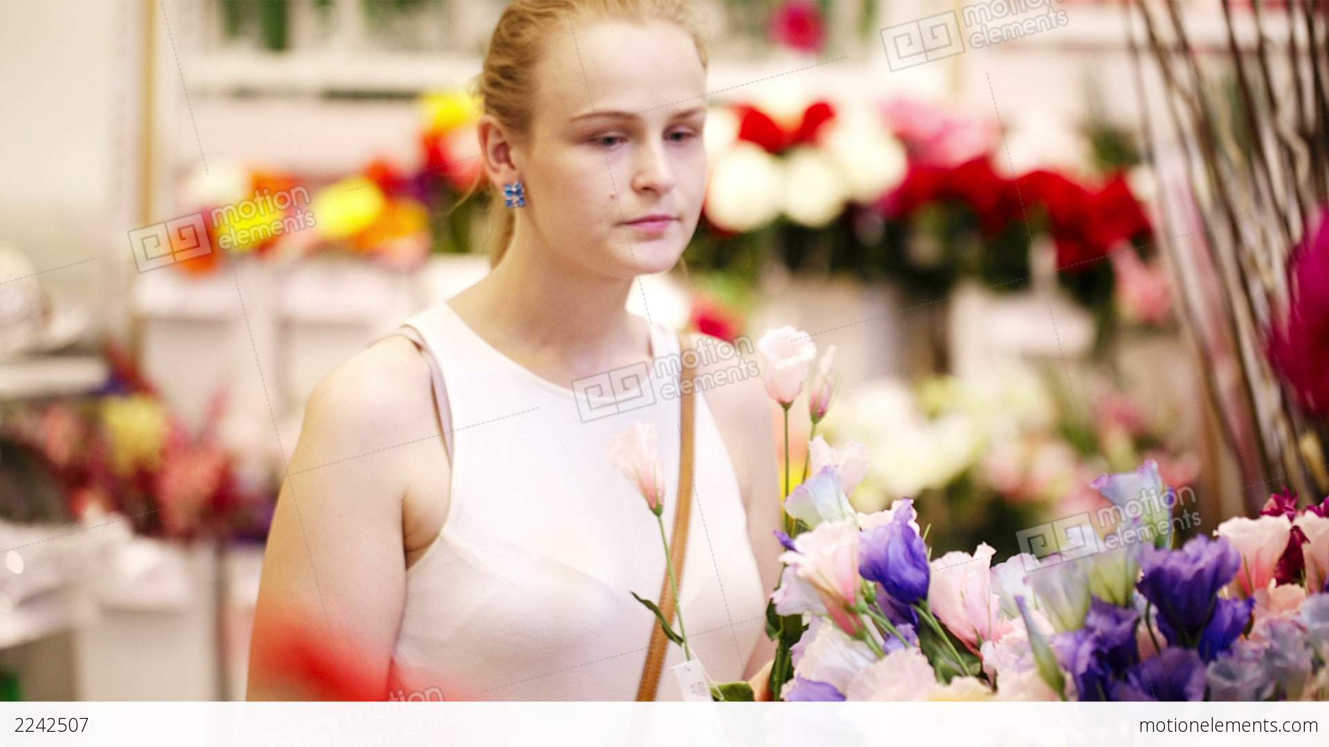 Beautiful Young Lady Buying Fresh Flowers Stock video footage | 2242507
