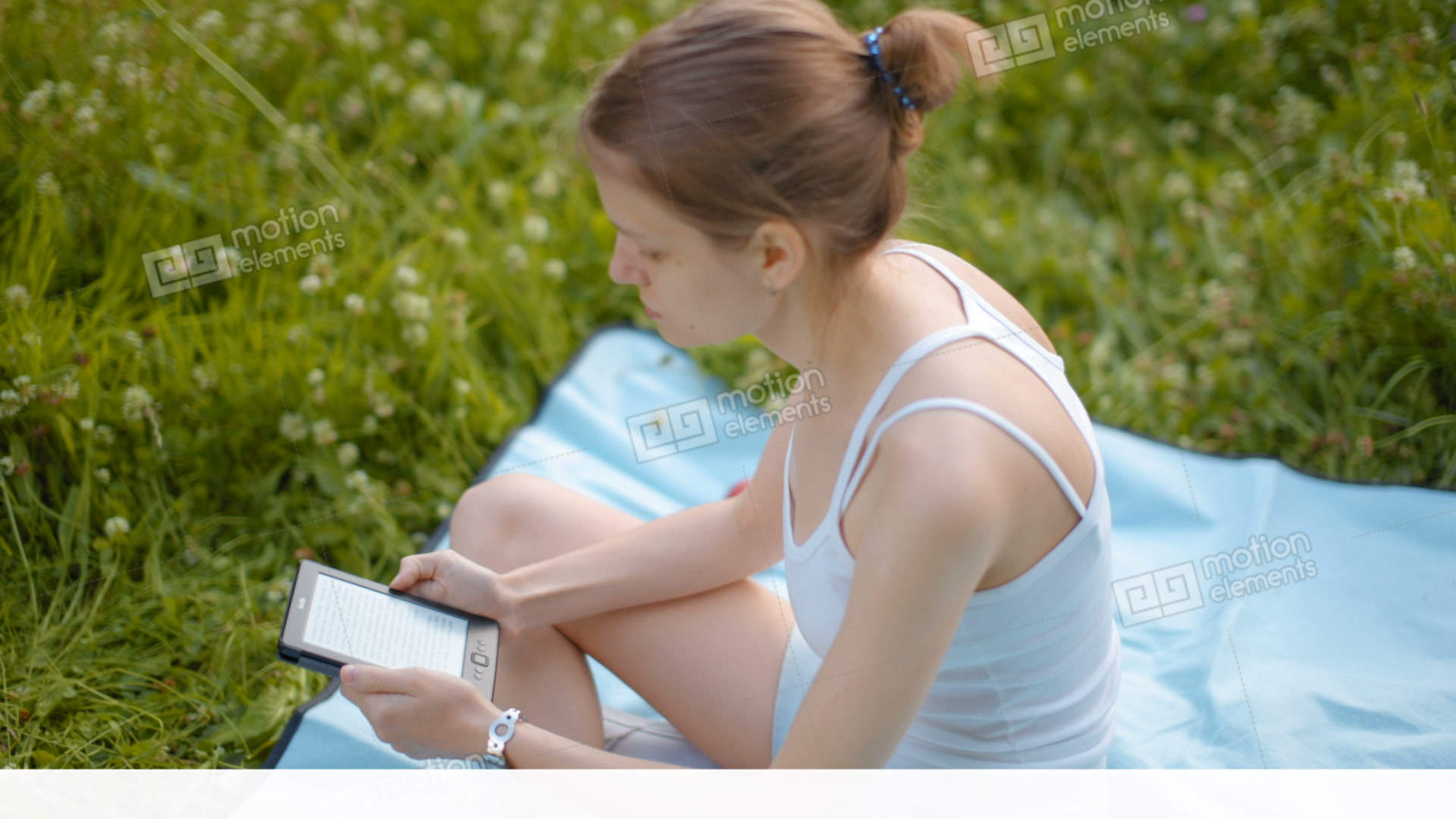 Young Beautiful Lady Is Reading The E-Book In The Park On A Blanket ...