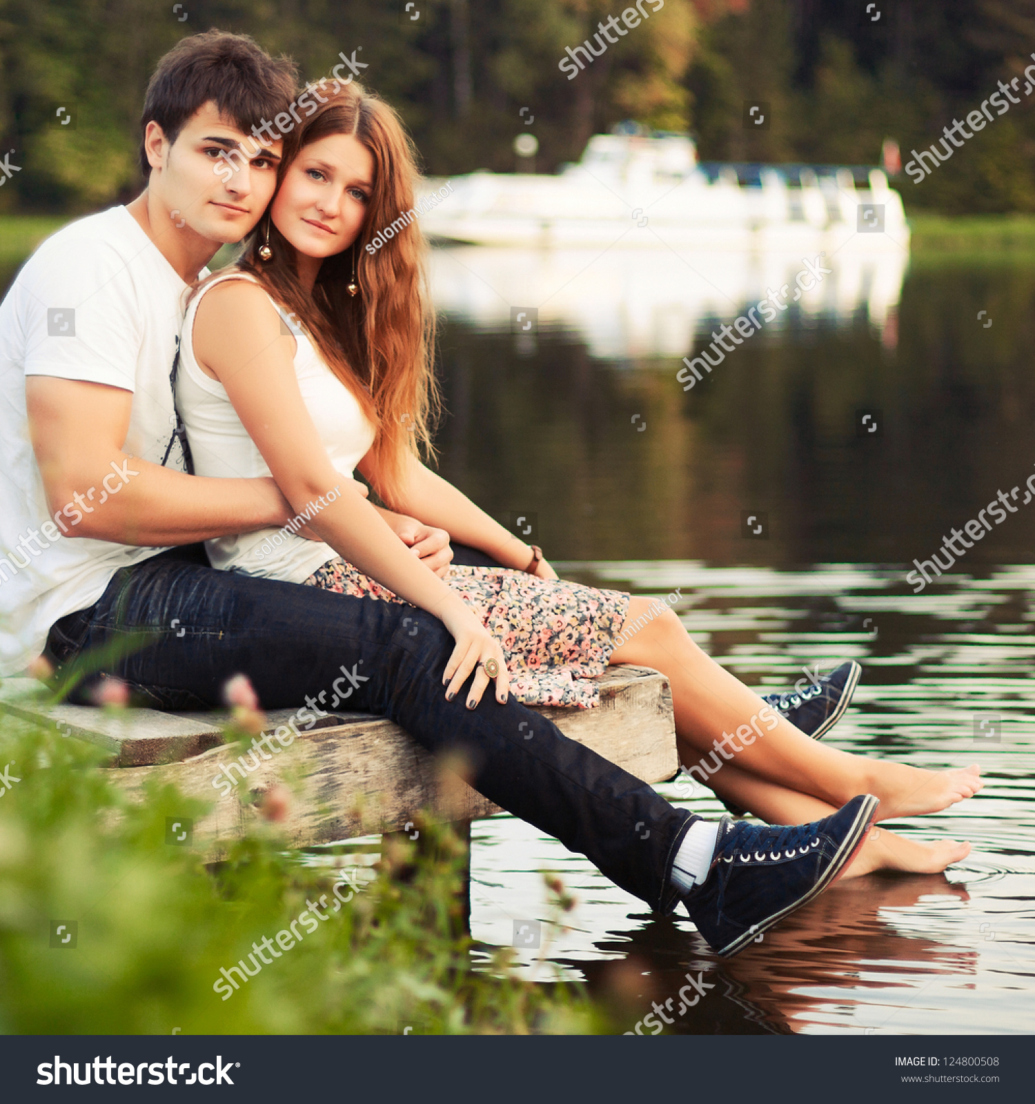 Portrait Beautiful Young Couple Sitting On Stock Photo (Royalty Free ...