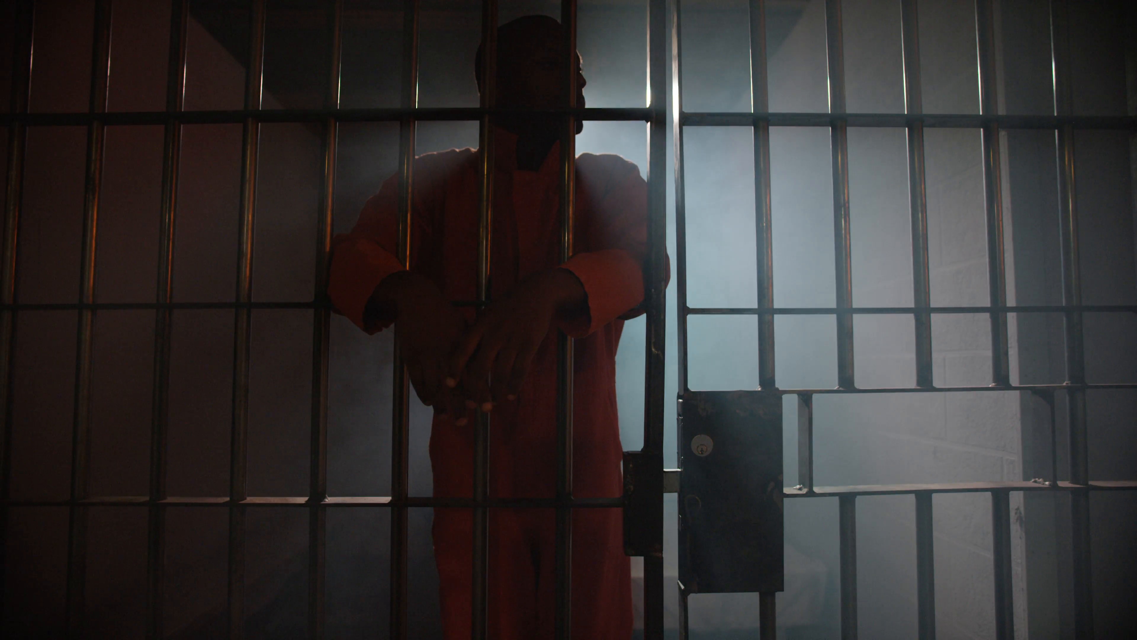 Silhouette of a prisoner behind bars in american prison Stock Video ...