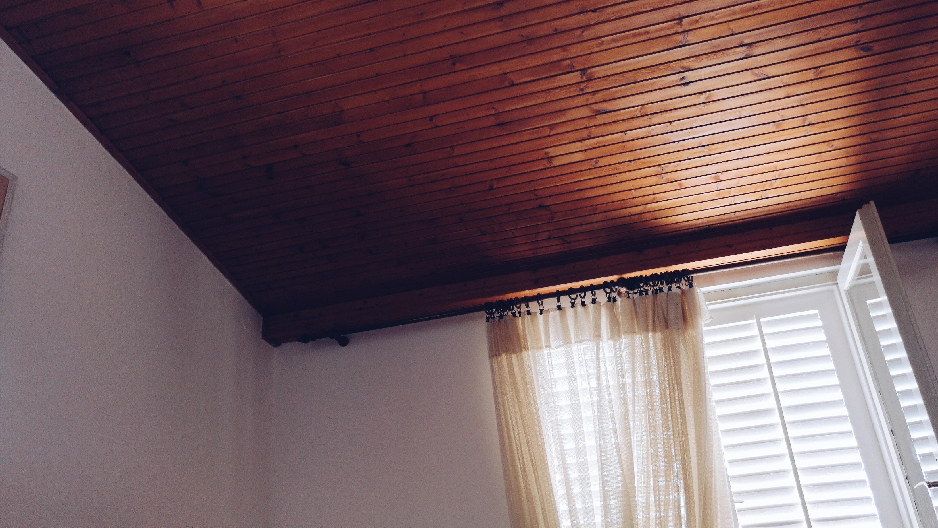 Beige window curtain on white window panel photo