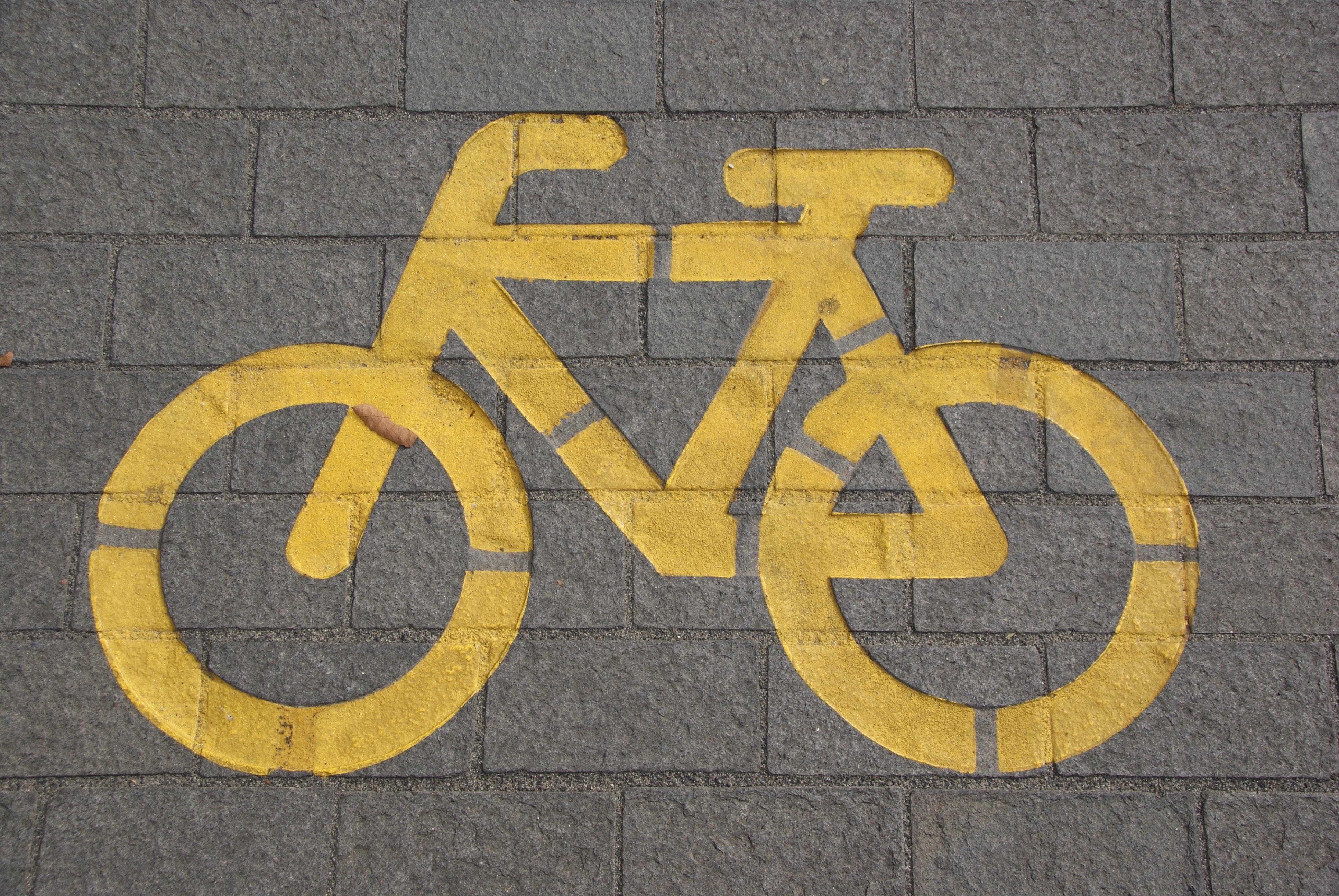 Bicycle lane on gray concrete road photo