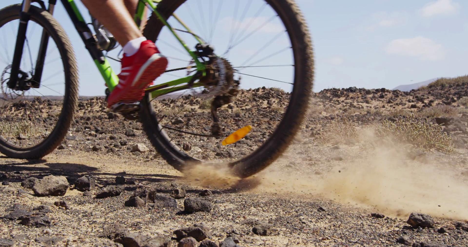 Mountain biking MTB cyclist braking hard locking brakes while ...