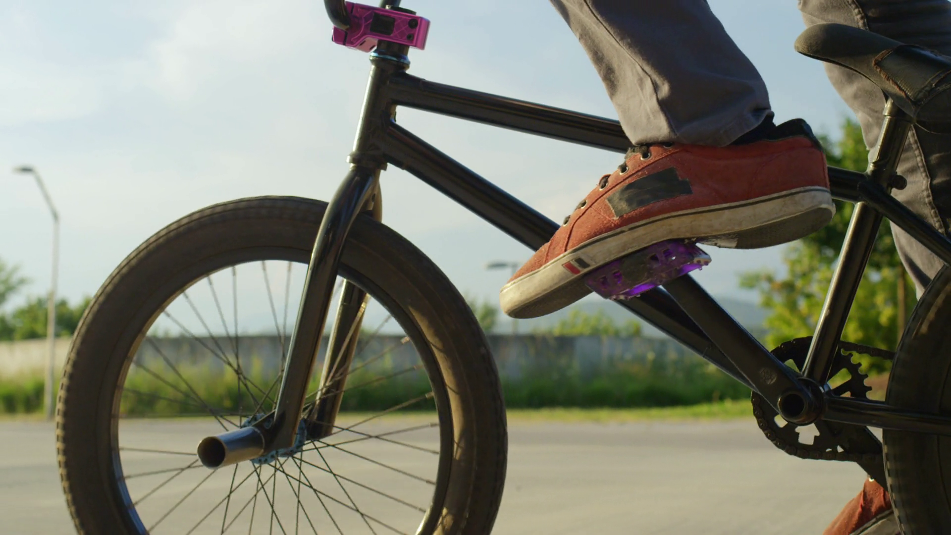 SLOW MOTION EXTREME CLOSE UP: Bmx rider pedaling bike and doing ...