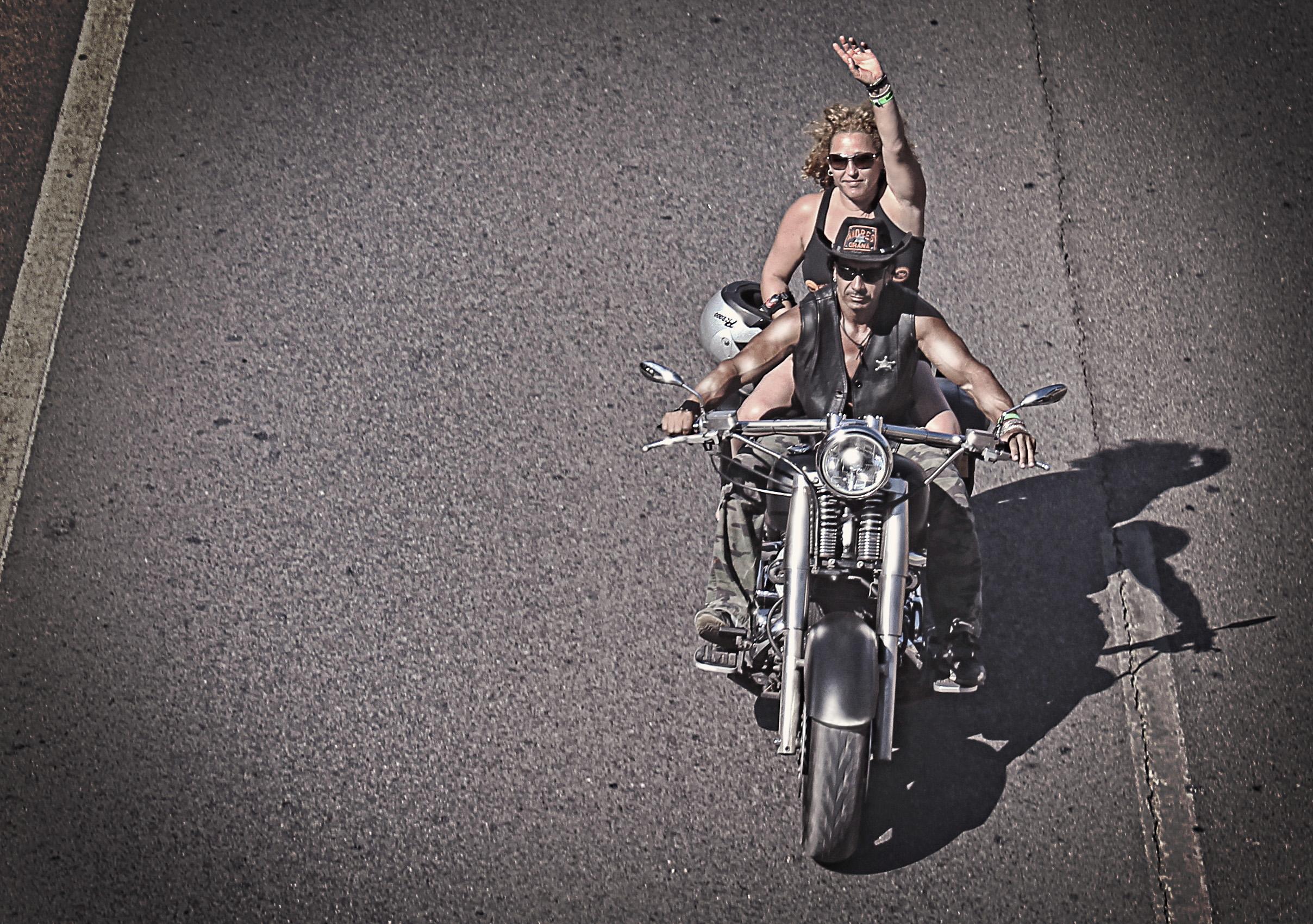 Biker waving on a chopper bike photo