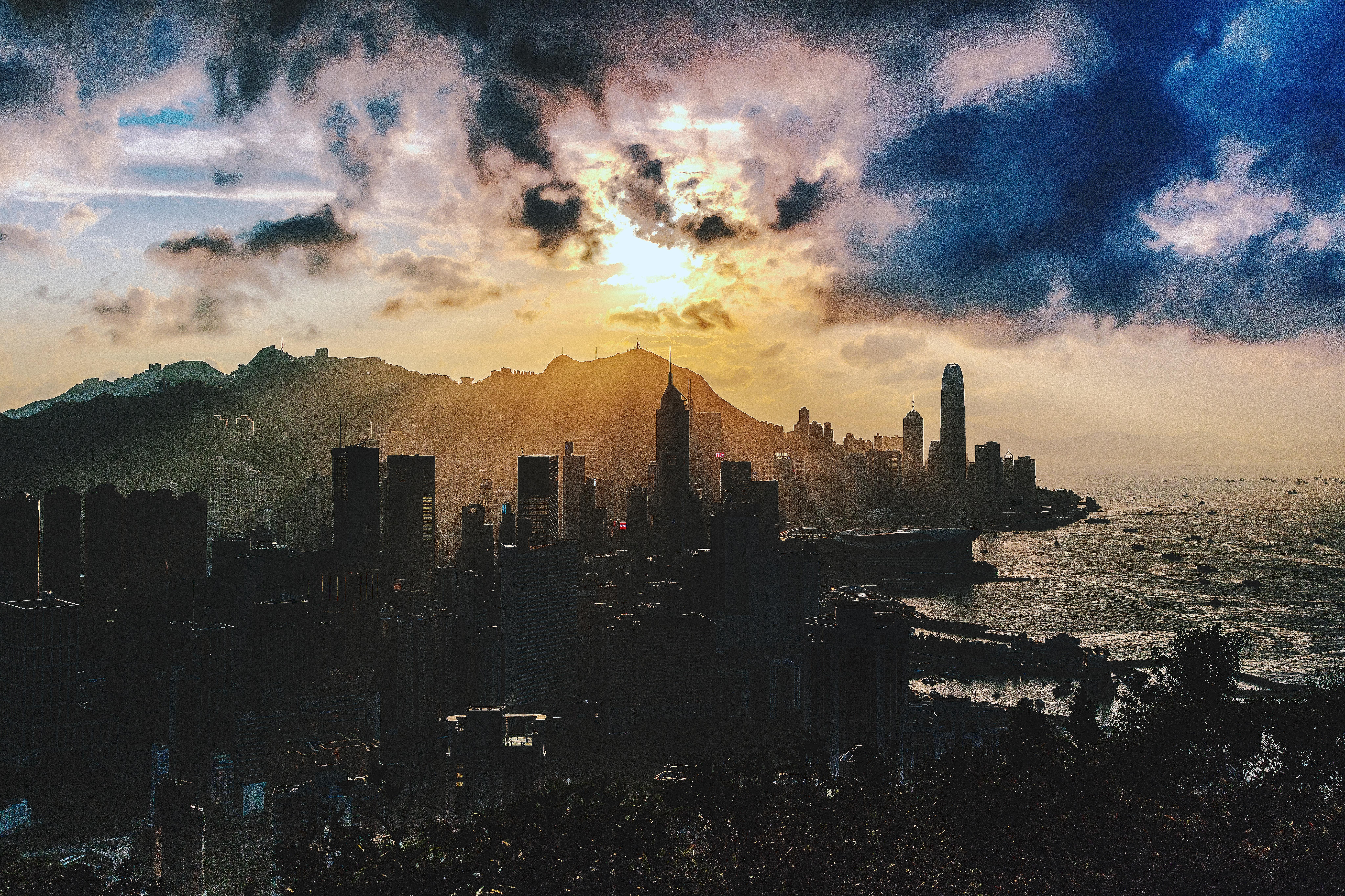 Bird's eye view of city near ocean during sunset photo