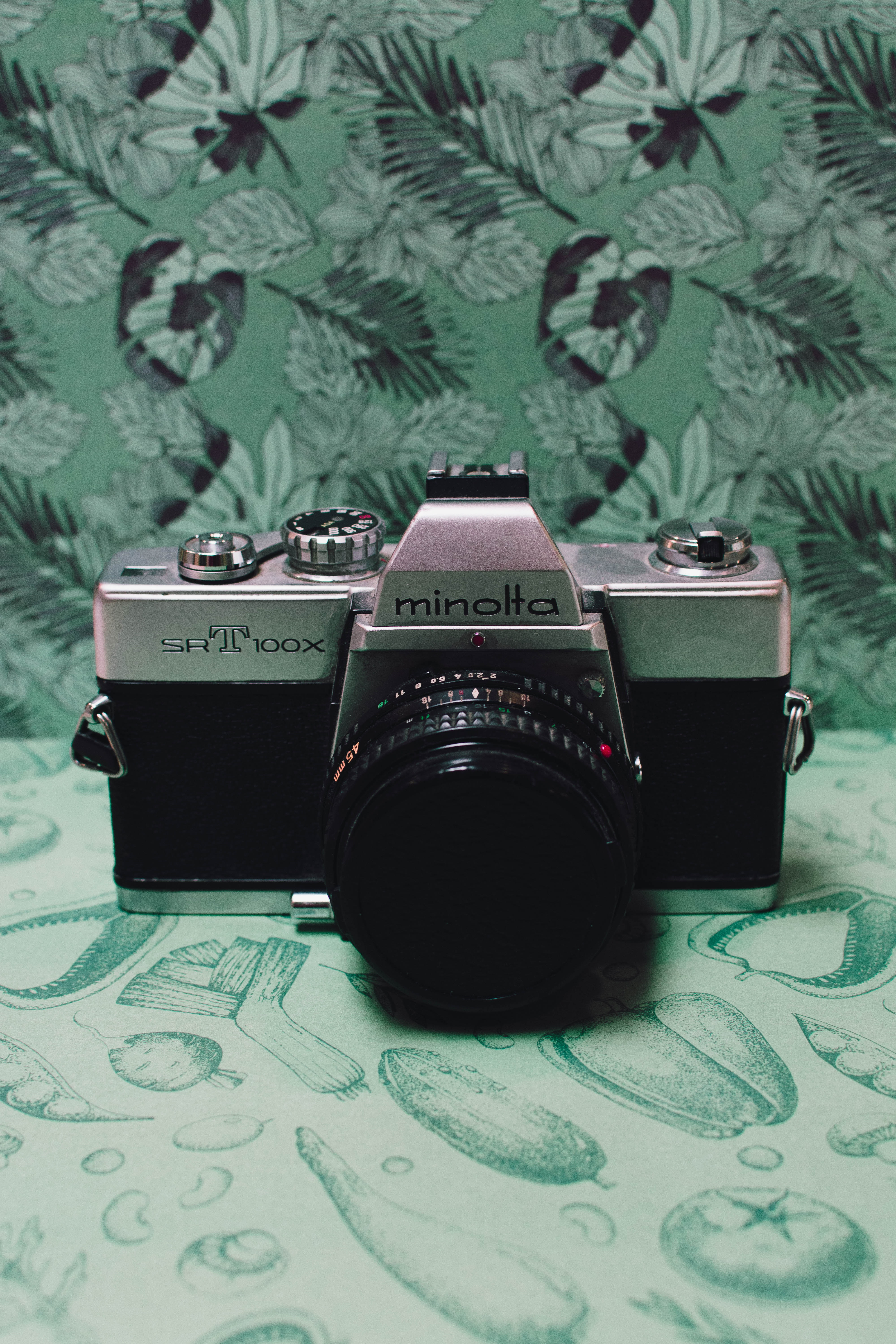 Black and Gray Film Camera on Green Floral Textile, Analog, Lens, Technology, Table, HQ Photo