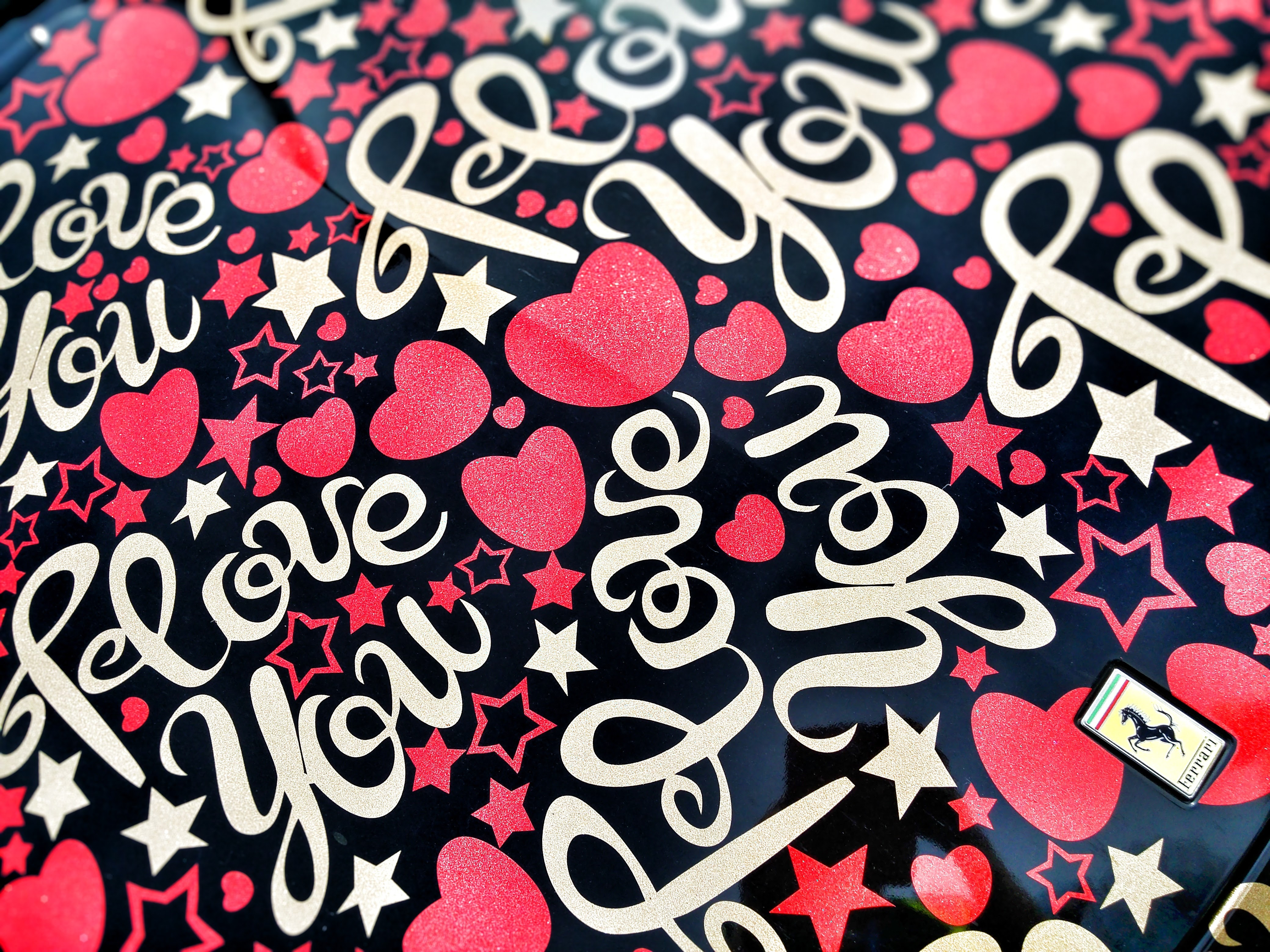 Black and multicolored i love you heart printed textile photo