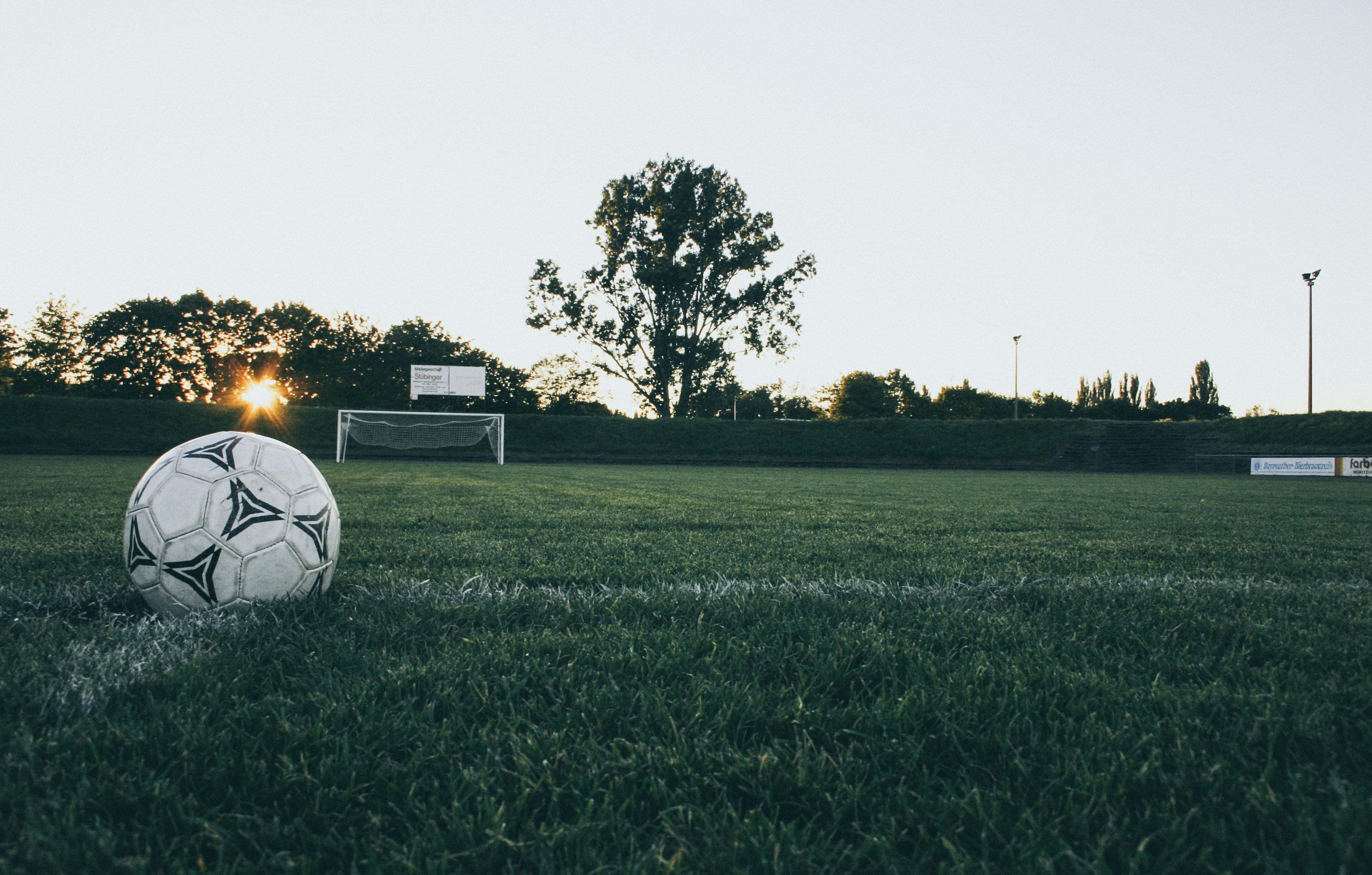 Black and White Soccer Ball on Green Grass Land during Daytime, Soccer photos, Sunrise, Sunset, Soccer images, HQ Photo
