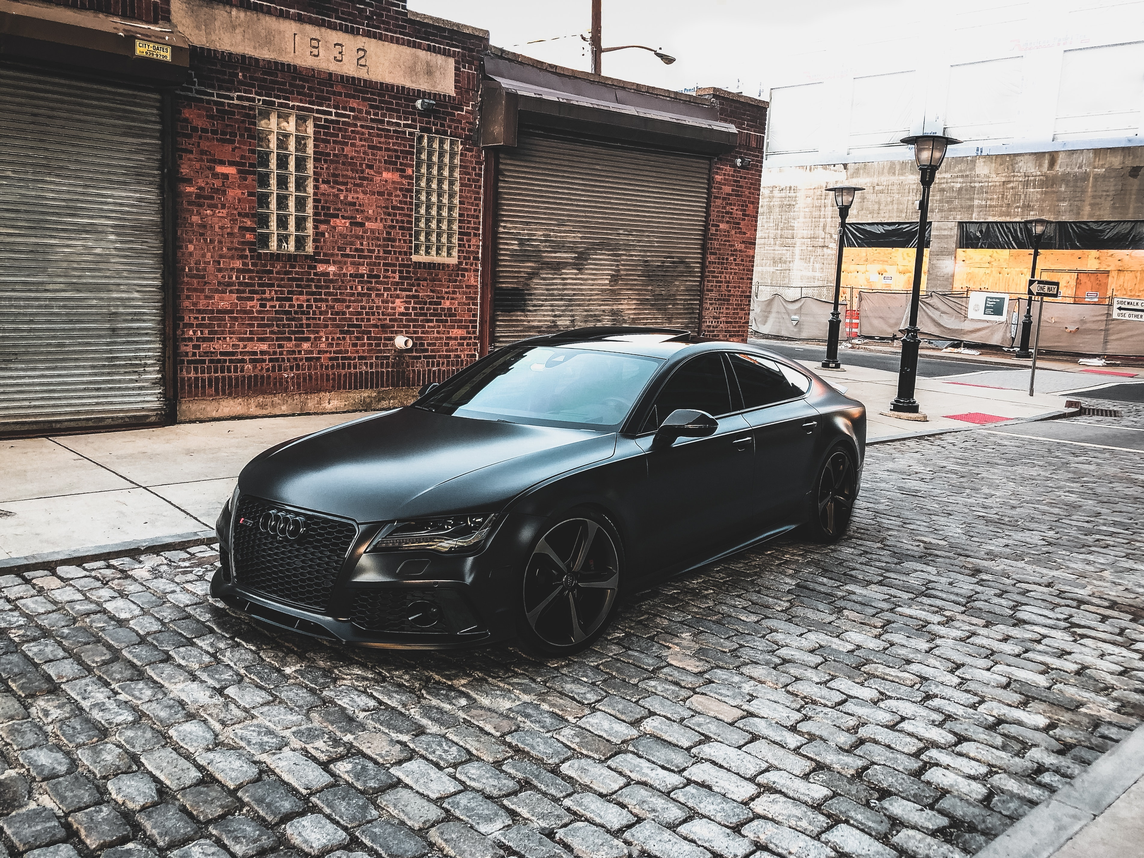 Black Audi A-series Parked Near Brown Brick House, Architecture, Outdoors, Vehicle, Urban, HQ Photo