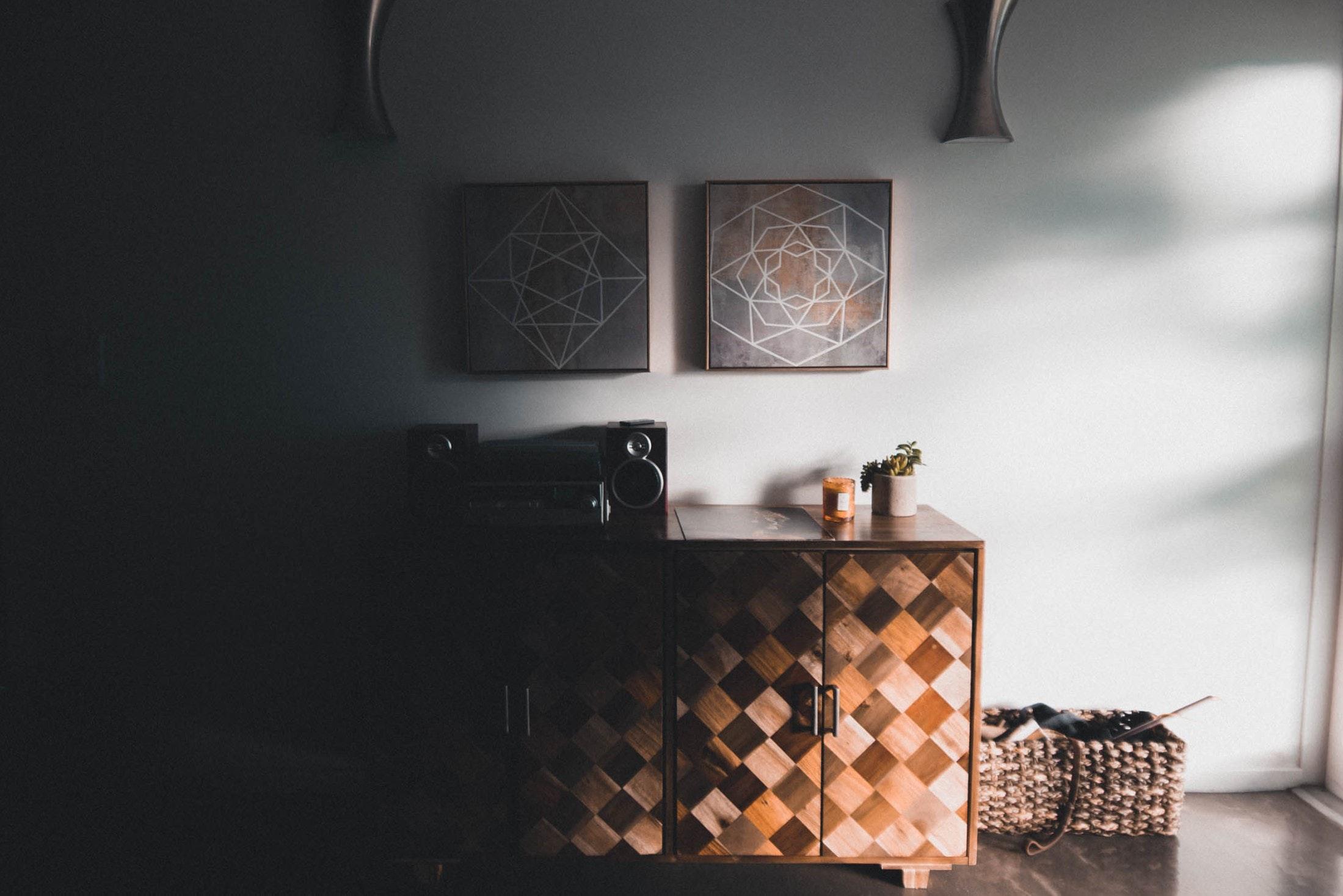 Black audio speaker on brown wooden cabinet photo